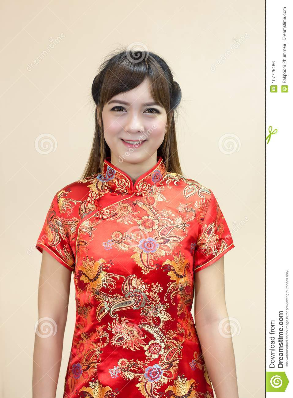 Closeup of asian woman greeting in traditional chinese or cheongsam download closeup of asian woman greeting in traditional chinese or cheongsam in chinese new year celebration m4hsunfo
