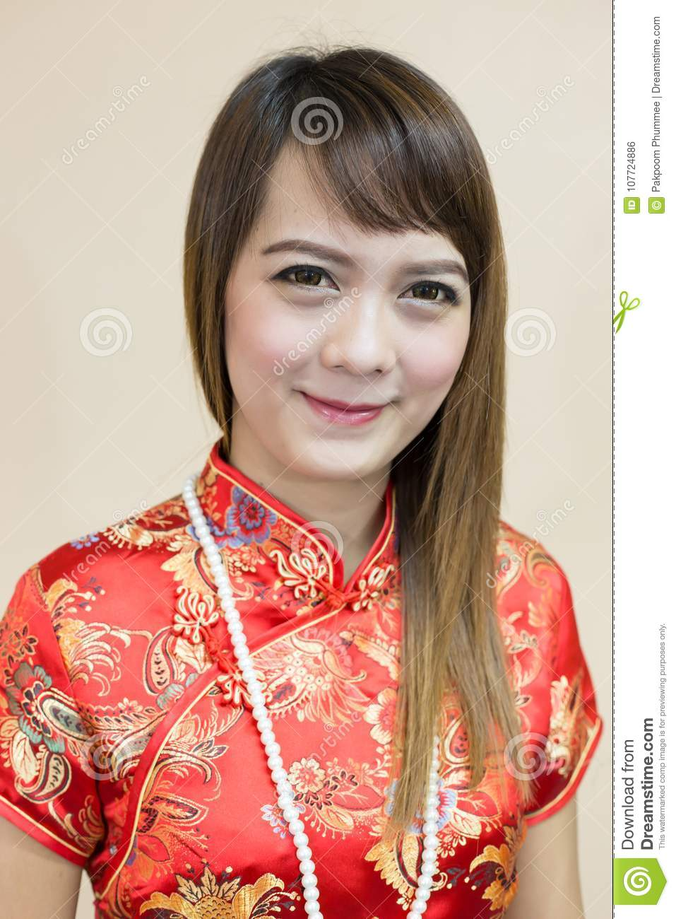 Closeup of asian woman greeting in traditional chinese or cheongsam download closeup of asian woman greeting in traditional chinese or cheongsam with pearl in chinese new m4hsunfo
