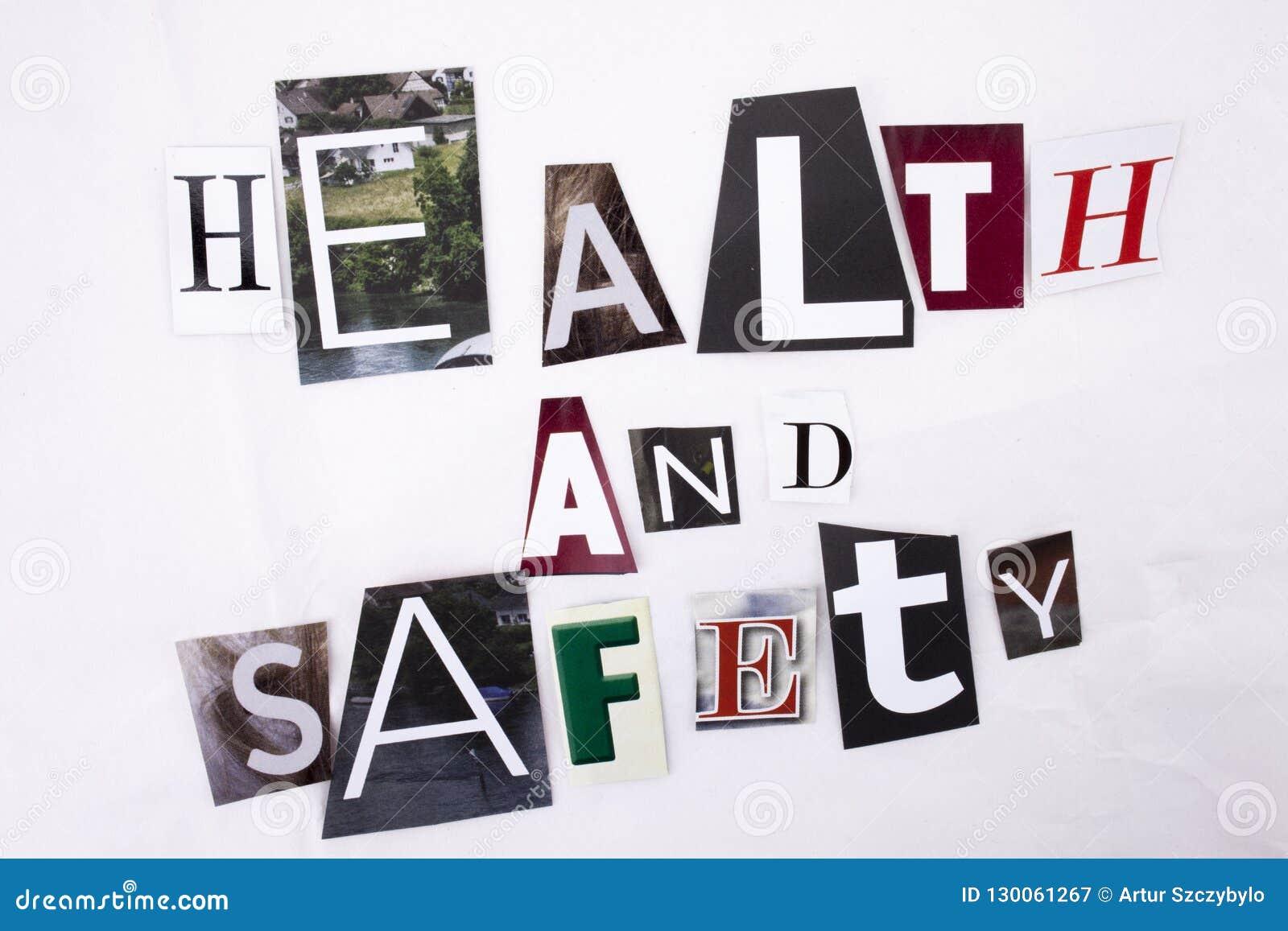 Closeup av en hand som skriver ett meddelandeord som skriver HÄLSA och säkerhet som göras av olika bokstäver för tidskrifttidning