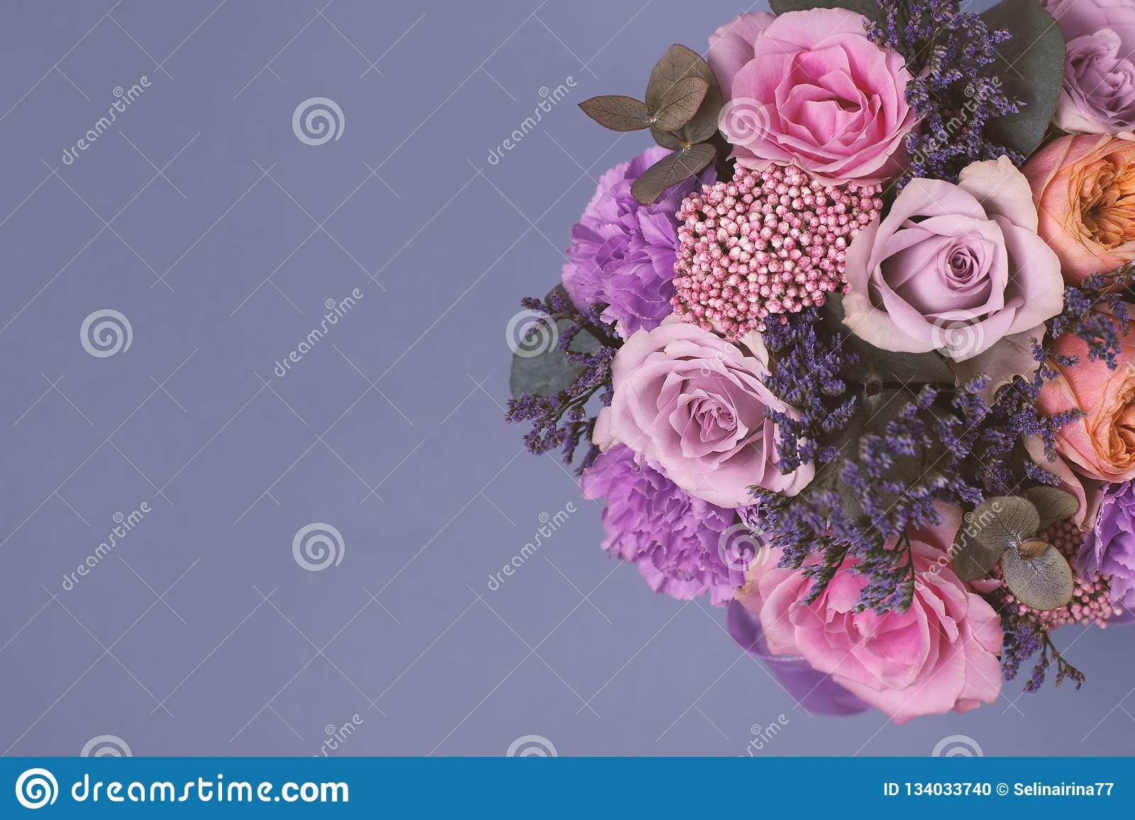Closeup beautiful flowers in pastel colors on a blue background. Greeting card, Mom`s day, wedding invitation, birthday
