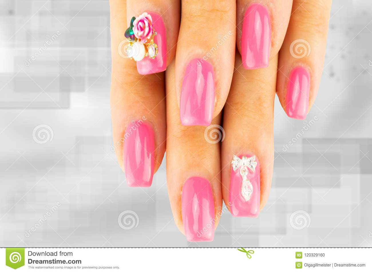 Closeup Of Beautiful Pink Nail Design At Female Fingers On Brigh