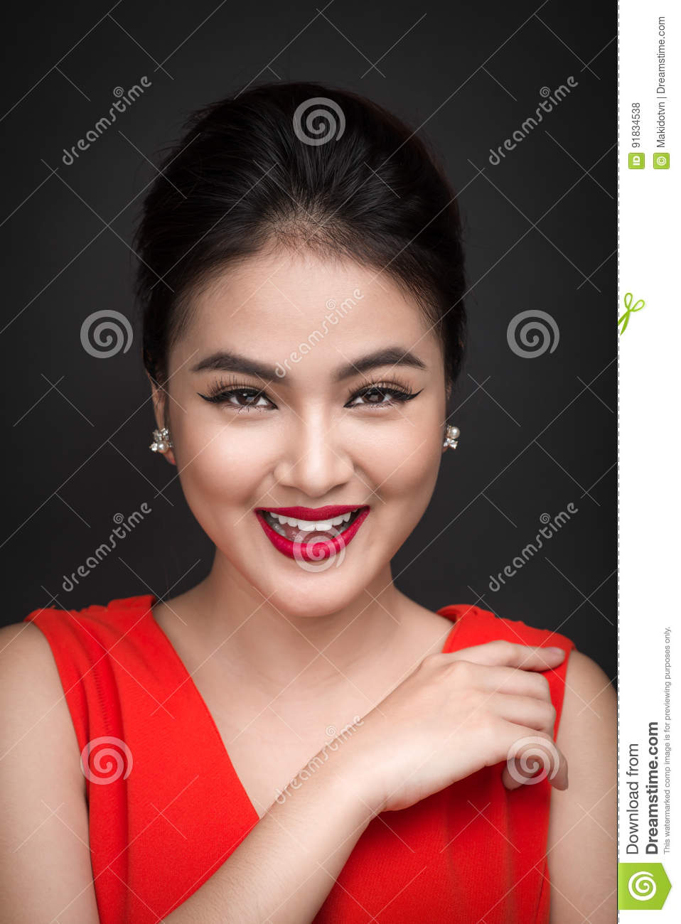 Closeup of beautiful girl with bright makeup and red lips. Beauty fashion asian woman.