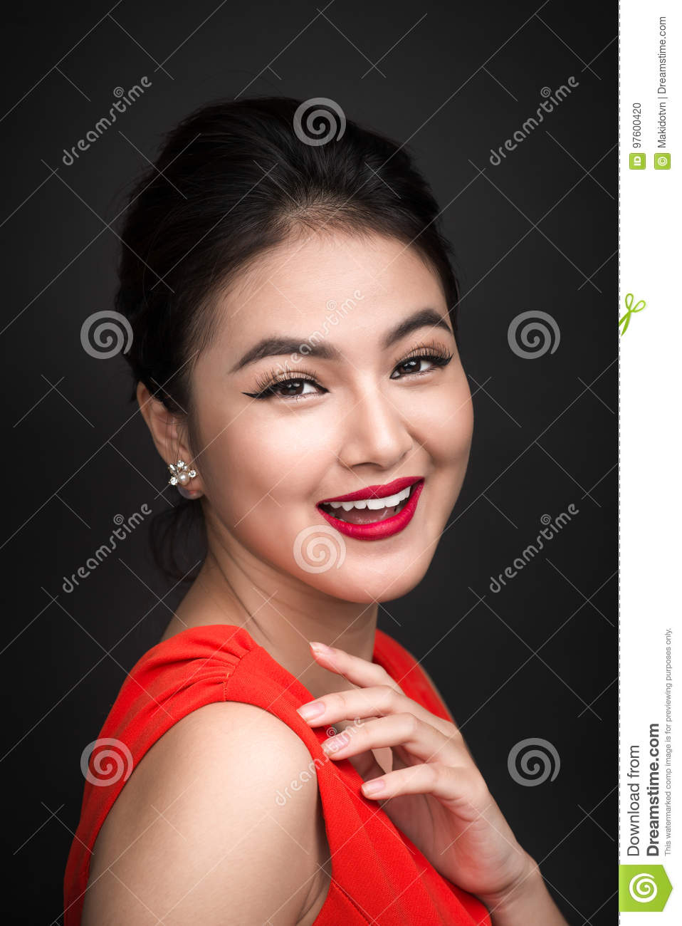 Closeup of beautiful girl with bright makeup and red lips.