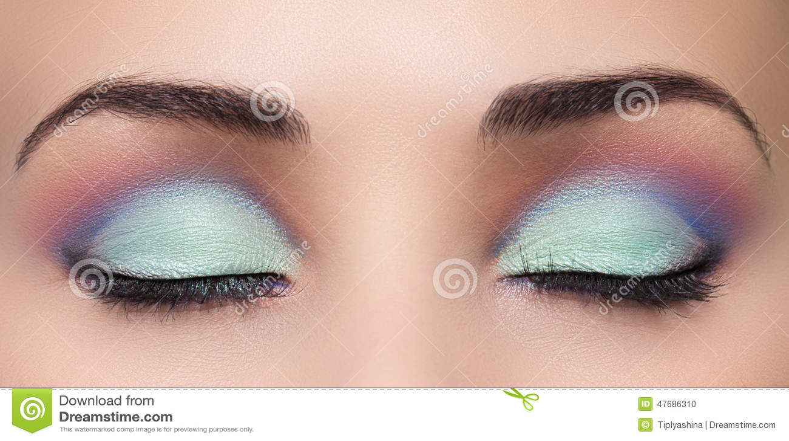 closeup of beautiful woman eye with makeup stock photo