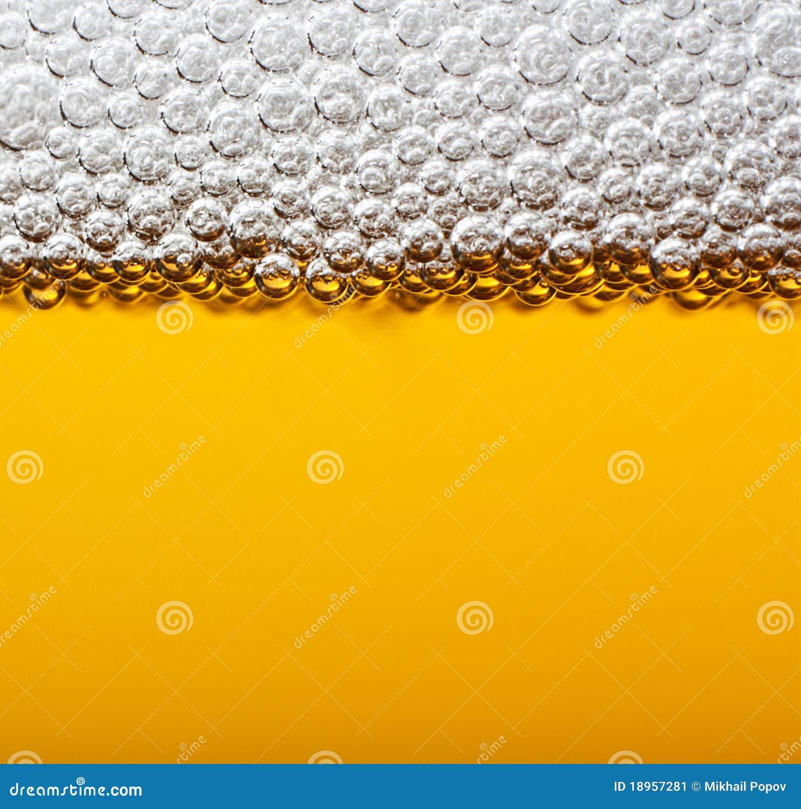 Closeup beer with foam.