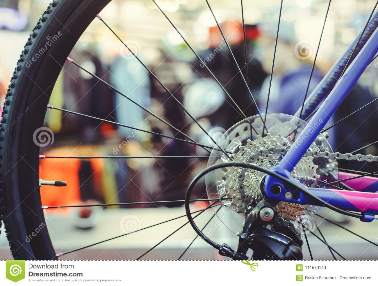 Closeup of a bicycle gears mechanism and chain on the rear wheel of mountain bike. Rear wheel cassette from a mountain bike. Close