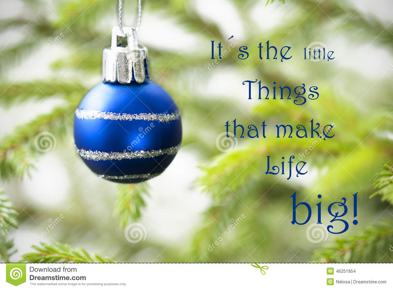 Closeup of a blue christmas ball with life quote stock for Christmas decoration quotes