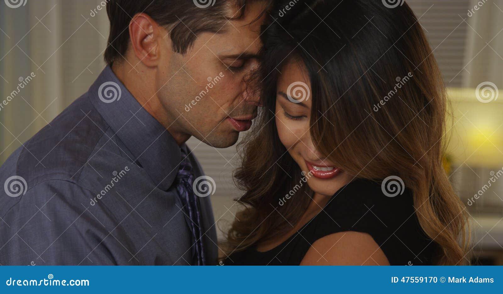 Closeup of boyfriend whispering into girlfriend s ear