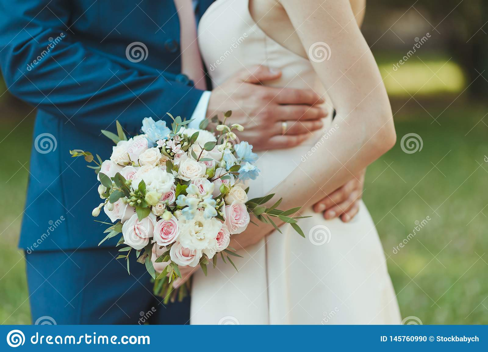 Closeup With Bride And Groom Hands And Bouquet. Bride, Holding A ...