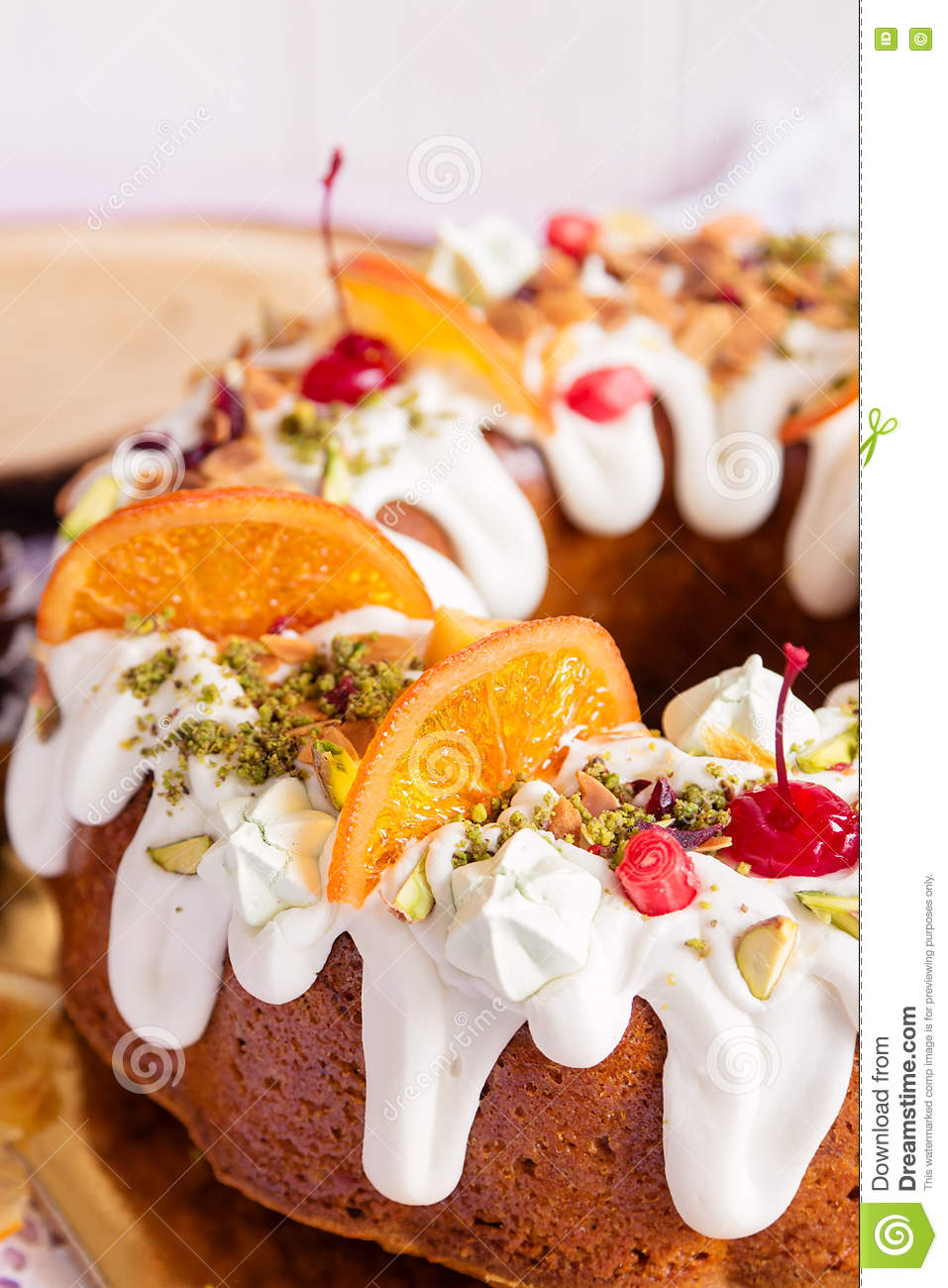 Closeup Of Bundt Cake With Shugar Icing And Fruit Stock Photo