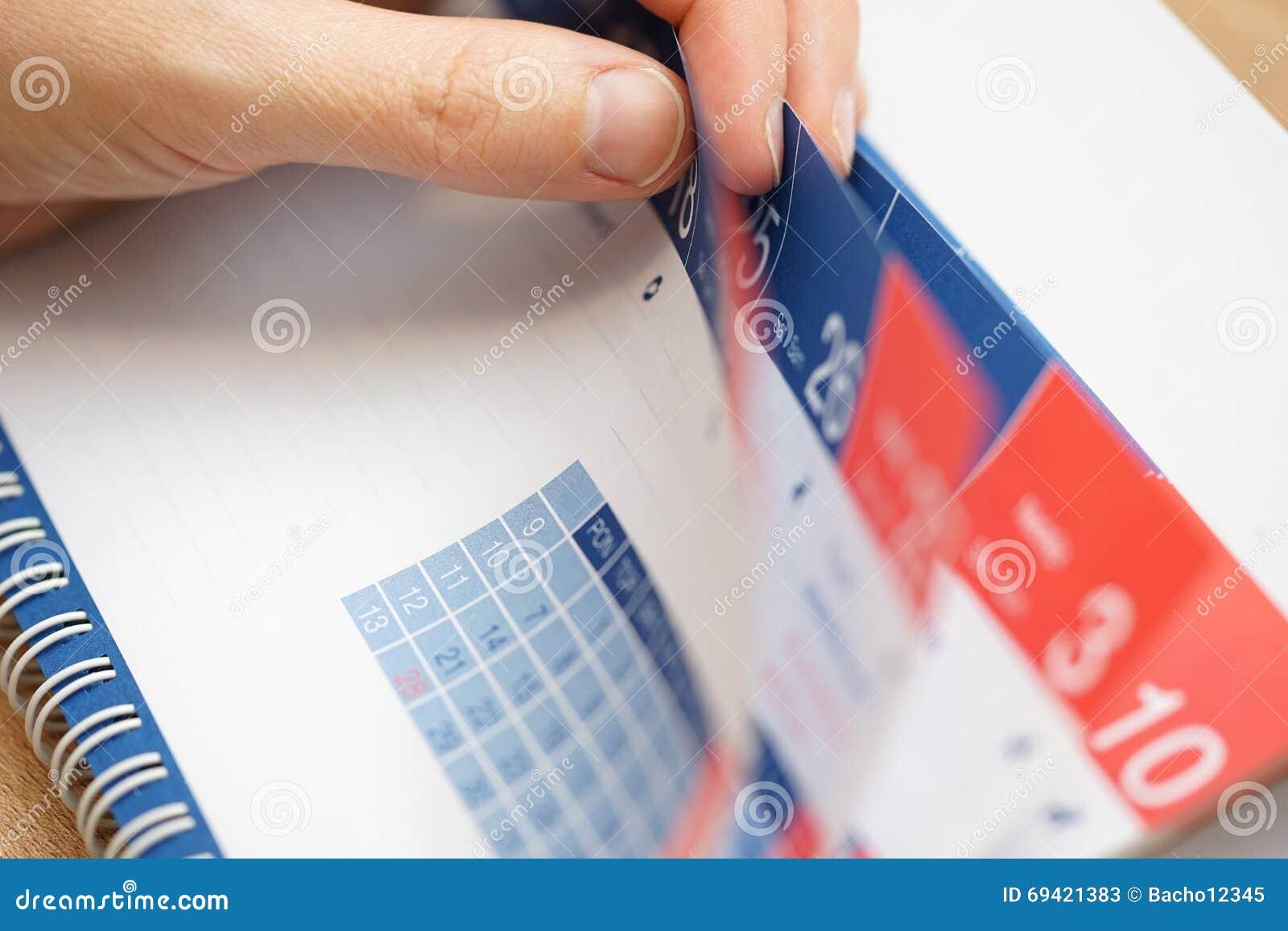 Closeup Of  Business Person Hands Checking Calendar Stock Photo