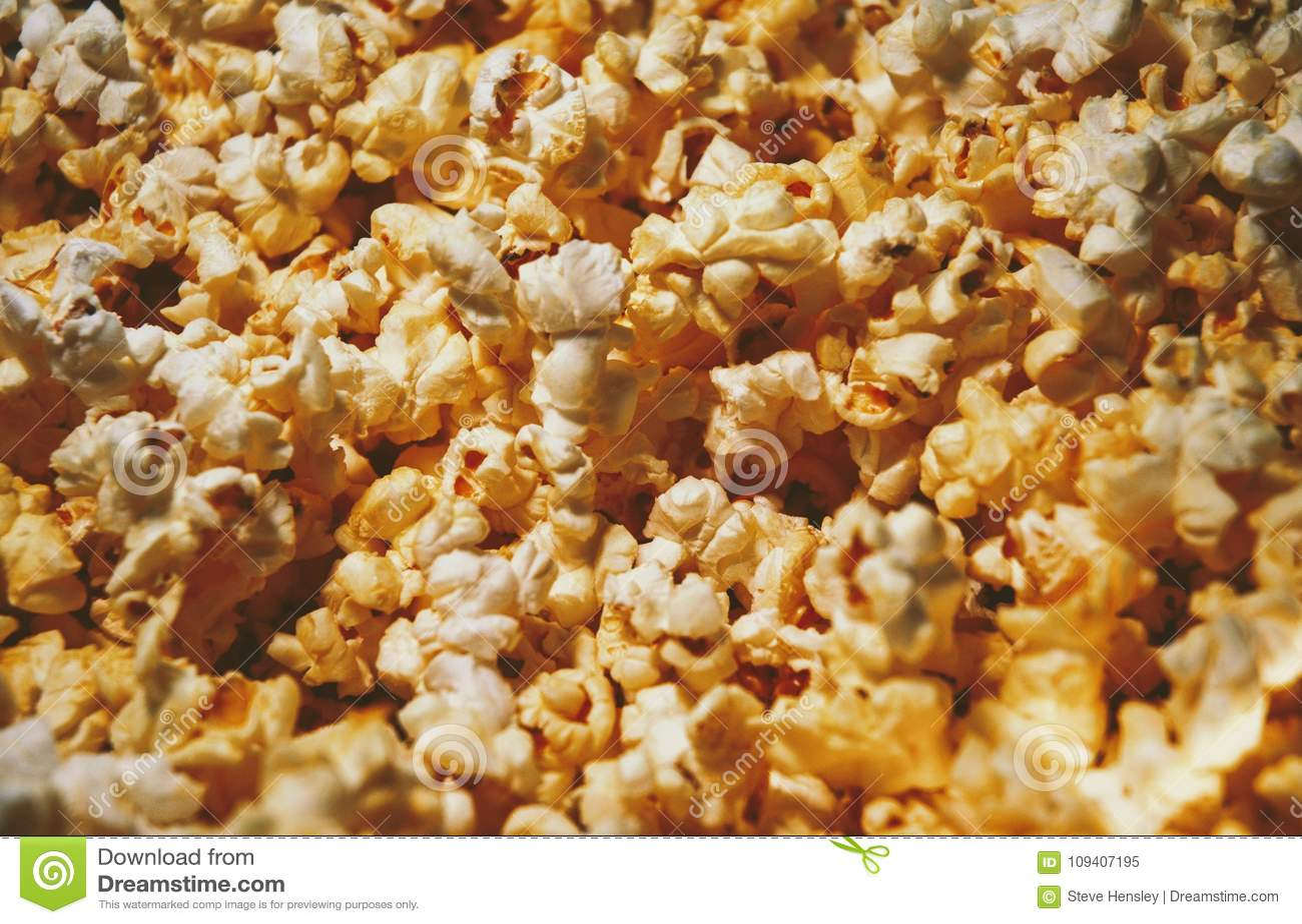 A Closeup Of Butter Popcorn Background Wallpaper Stock