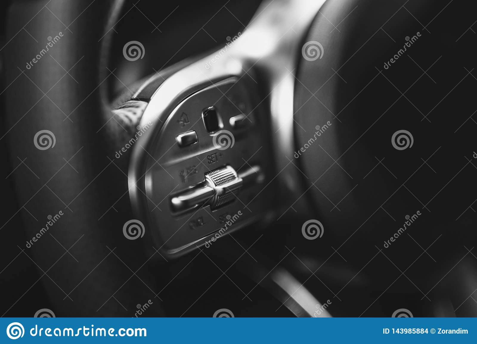 Closeup of car audio control button on the steering wheel