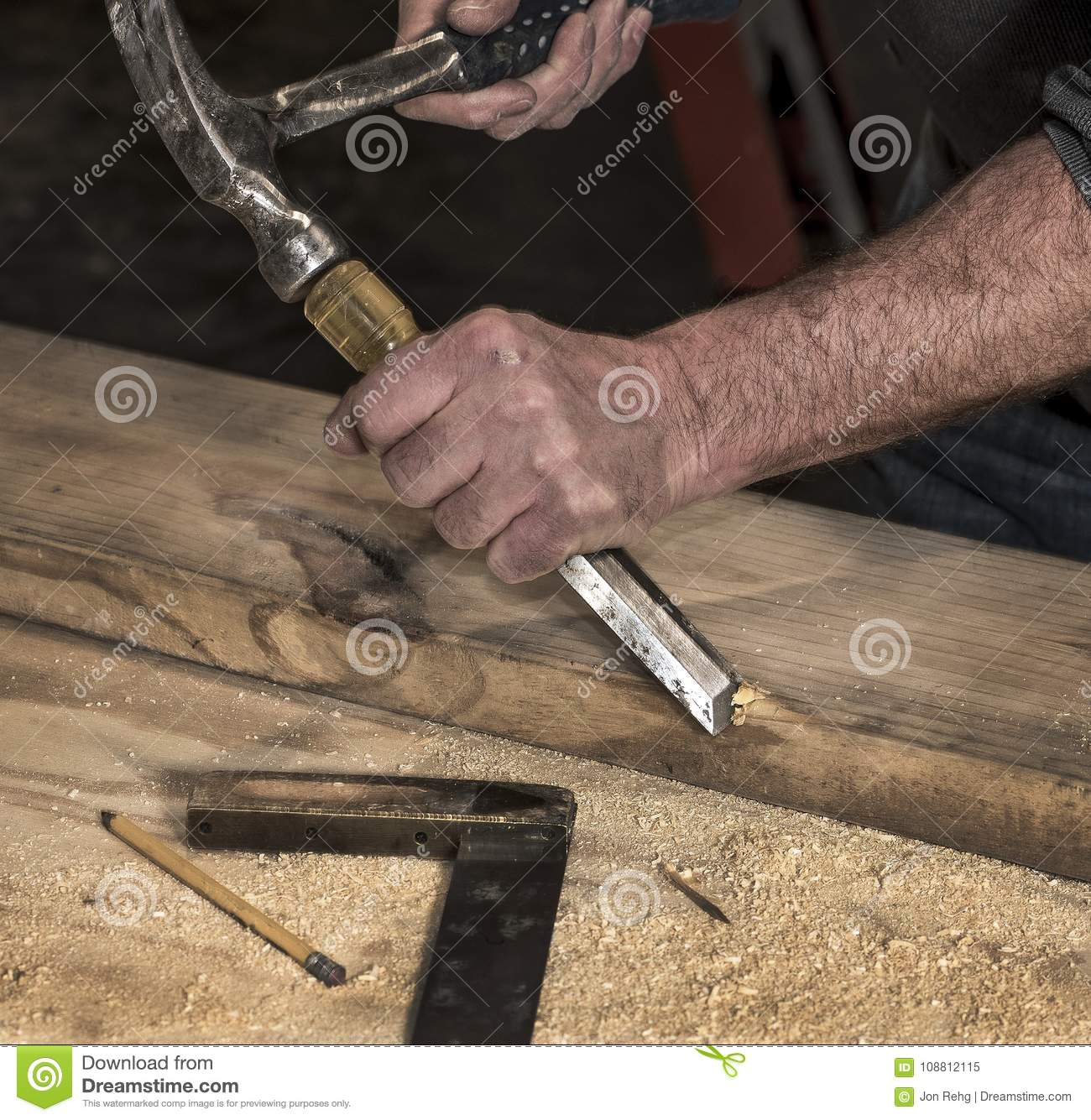 Closeup Of Carpenter S Rough Hands Chiseling Wood Board Using Hammer