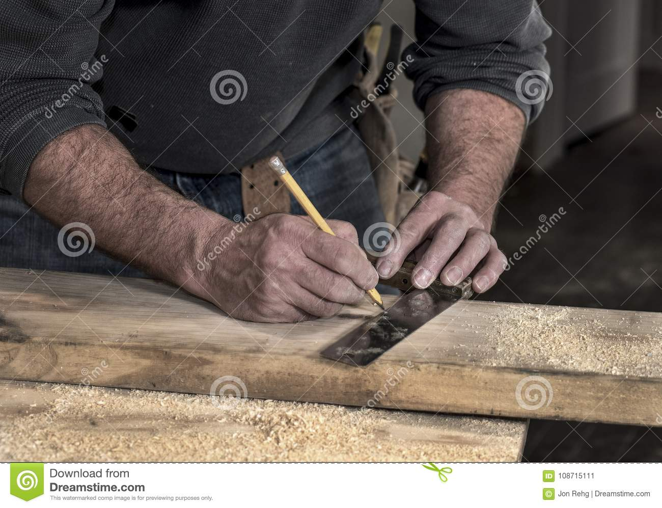 Closeup Of Carpenter S Rough Rugged Hands Using A Pencil And Old