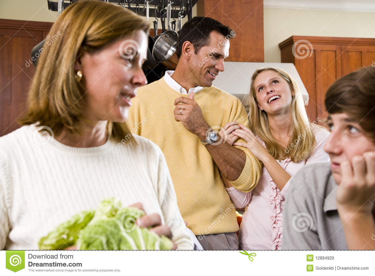 Closeup cheerful family in kitchen conversing