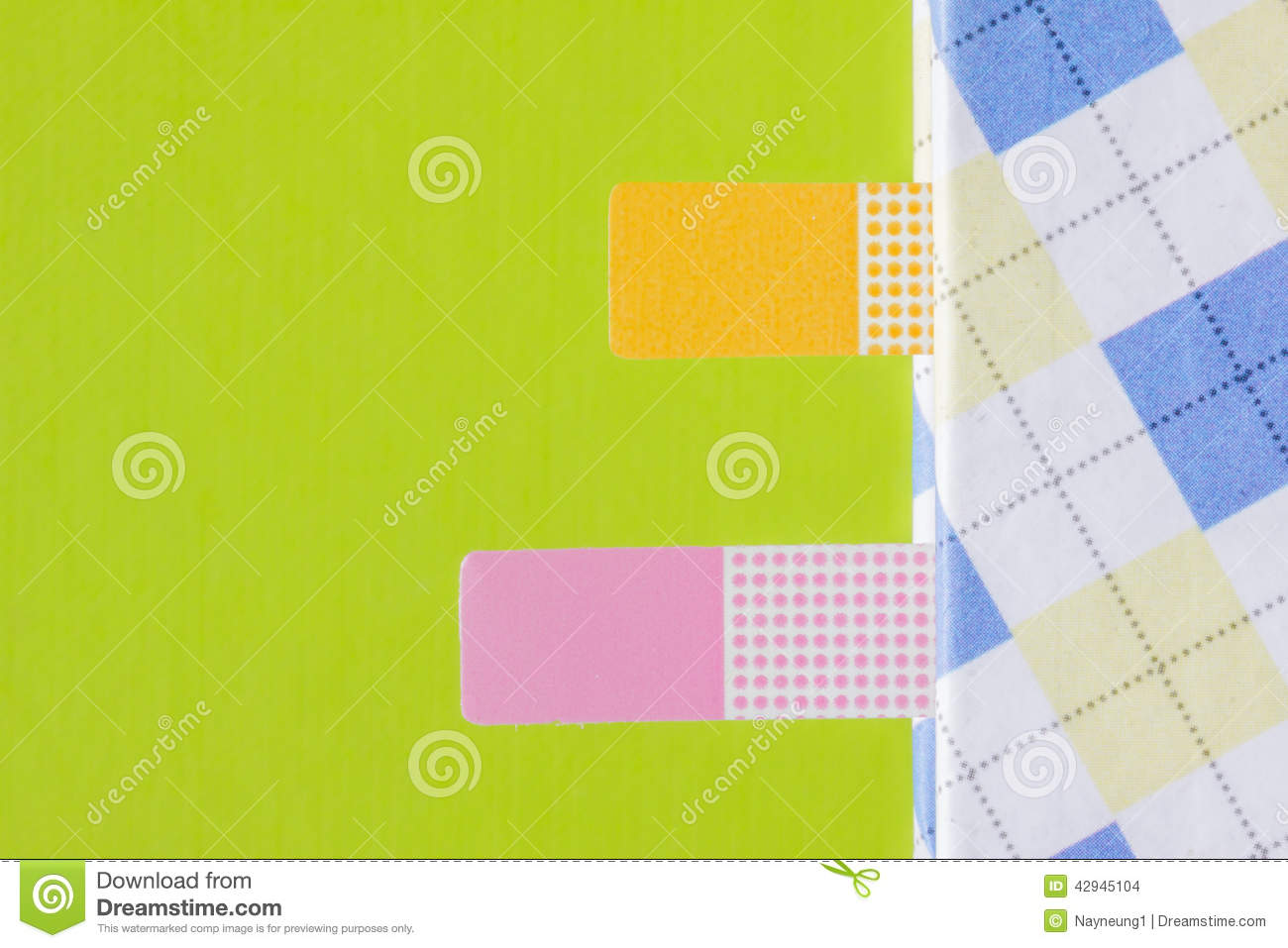 closeup colorful bookmark on green background. stock photo - image