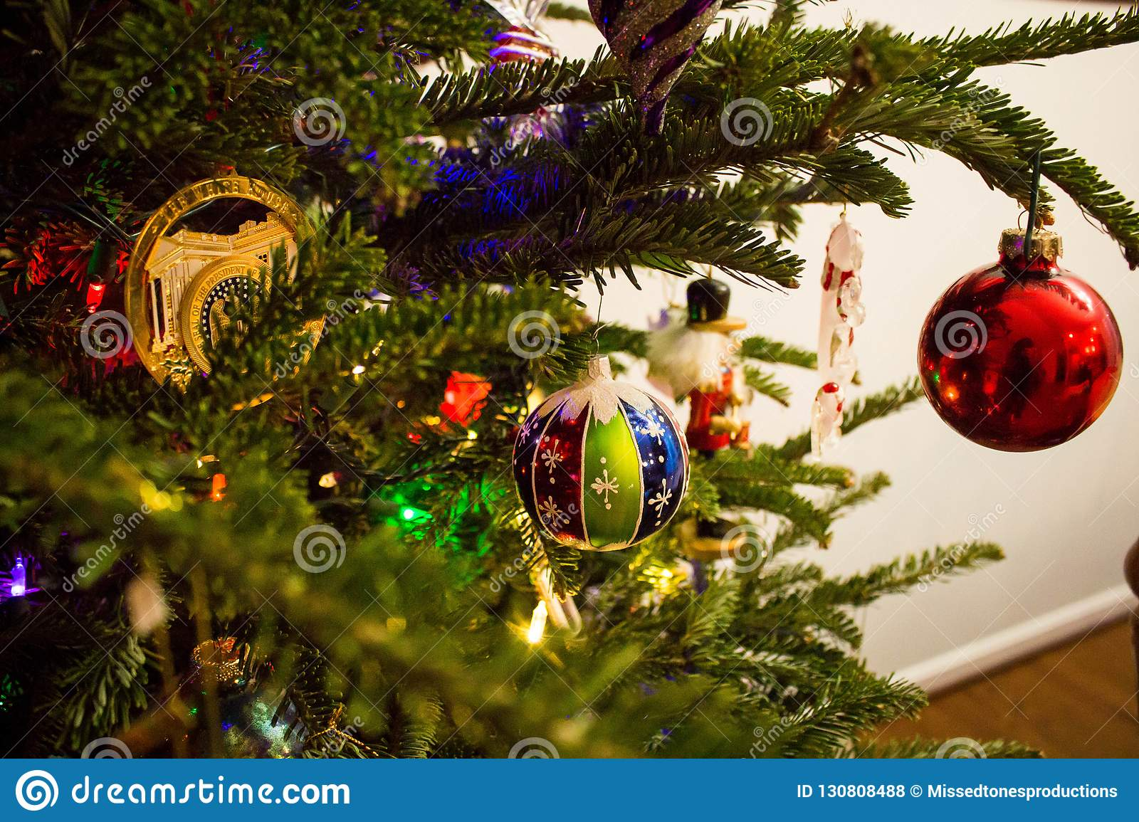 Glass Christmas Ornaments on a Green Tree