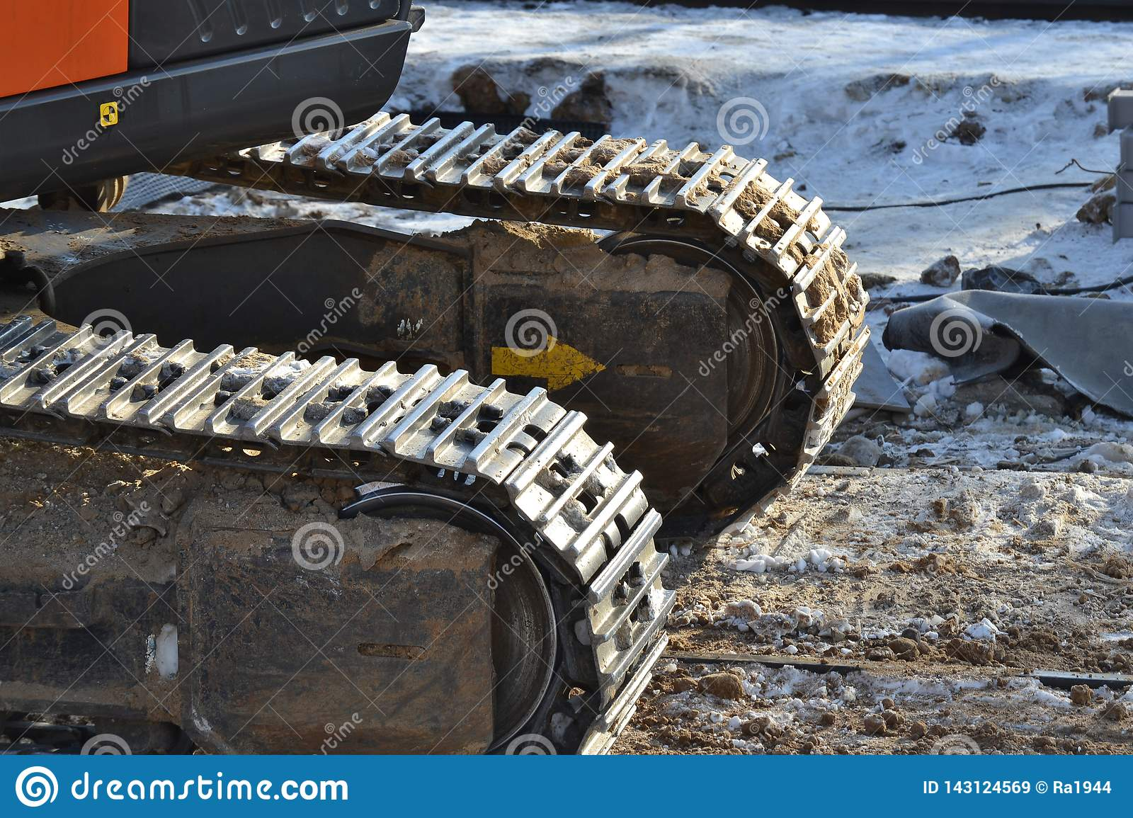 Closeup Continuous tracks or Tracked wheel of excavator or backhoe on the soil floor
