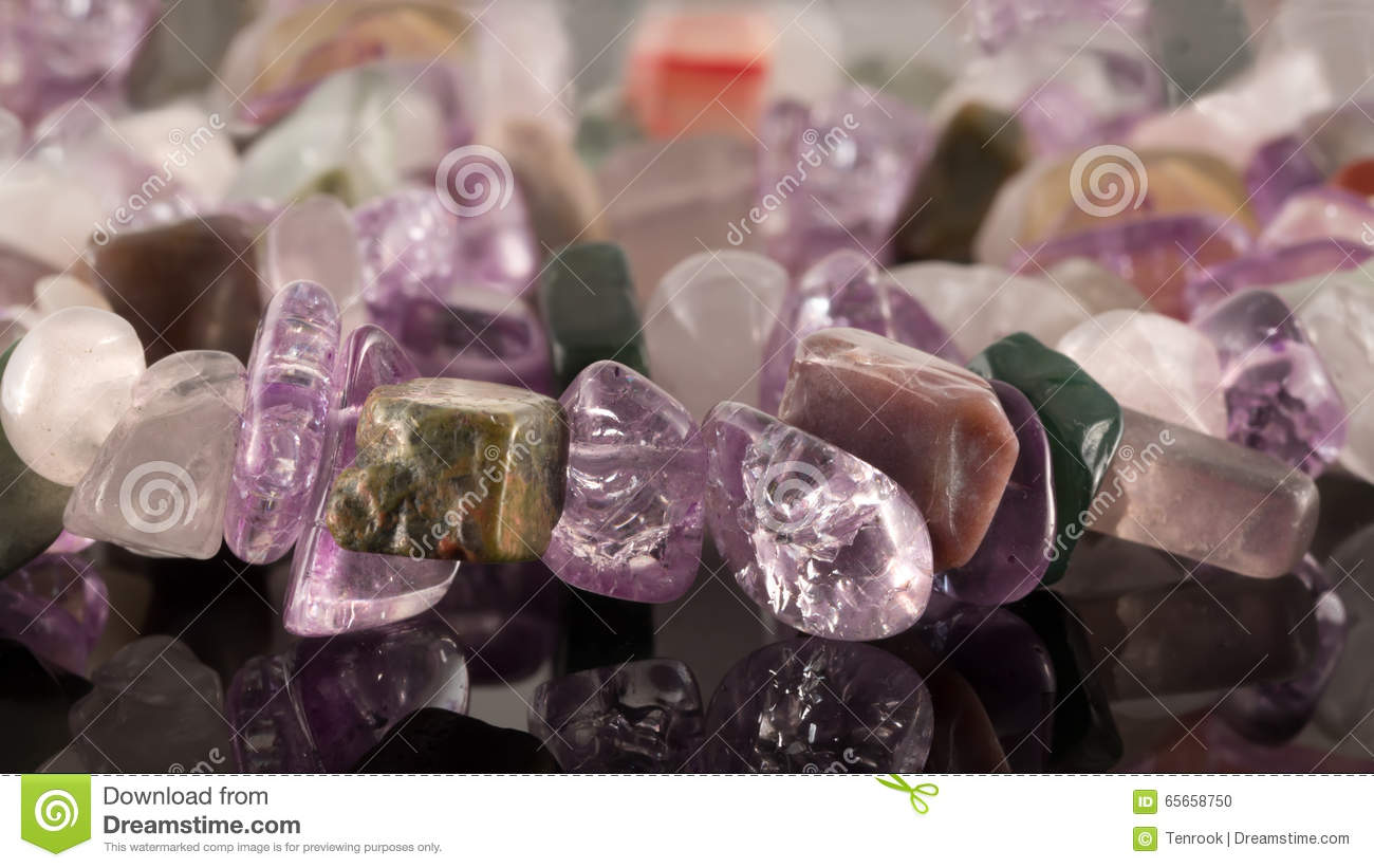 Closeup Crystals Of Amethyst, Fluorite, Jasper, Carnelian And Rose