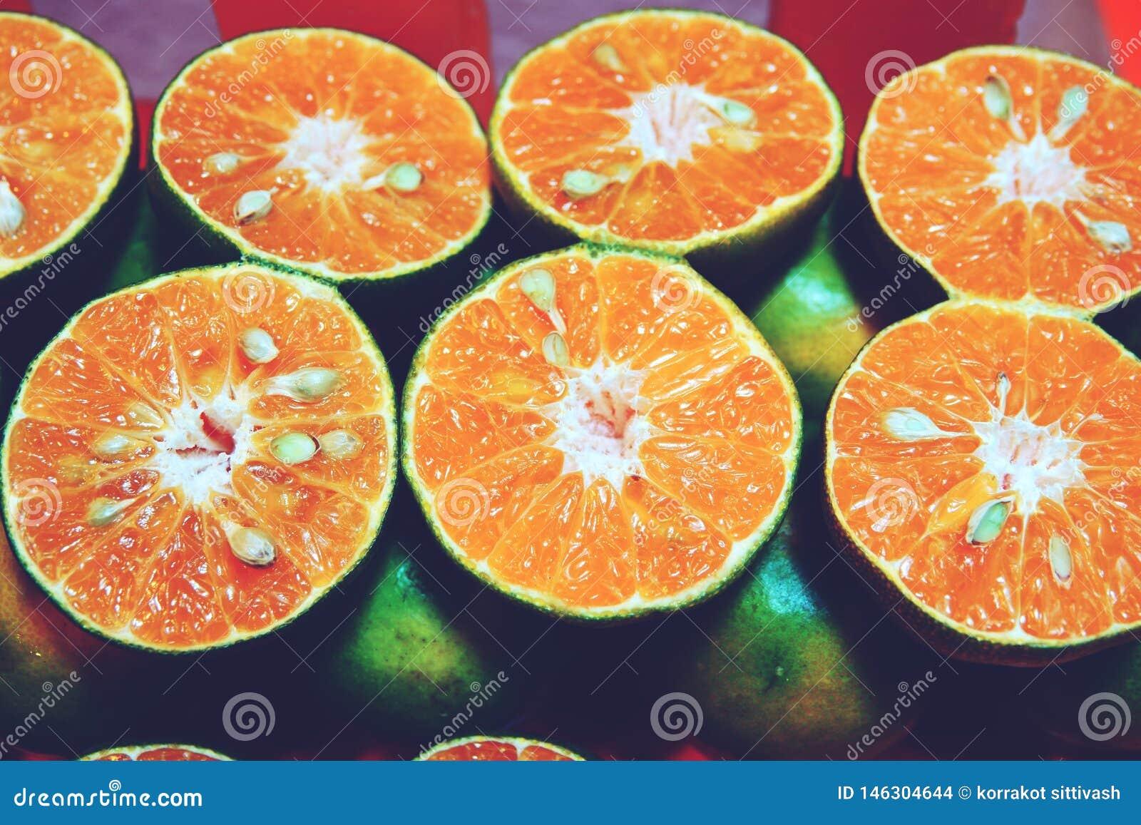 Closeup of cut oranges on a market