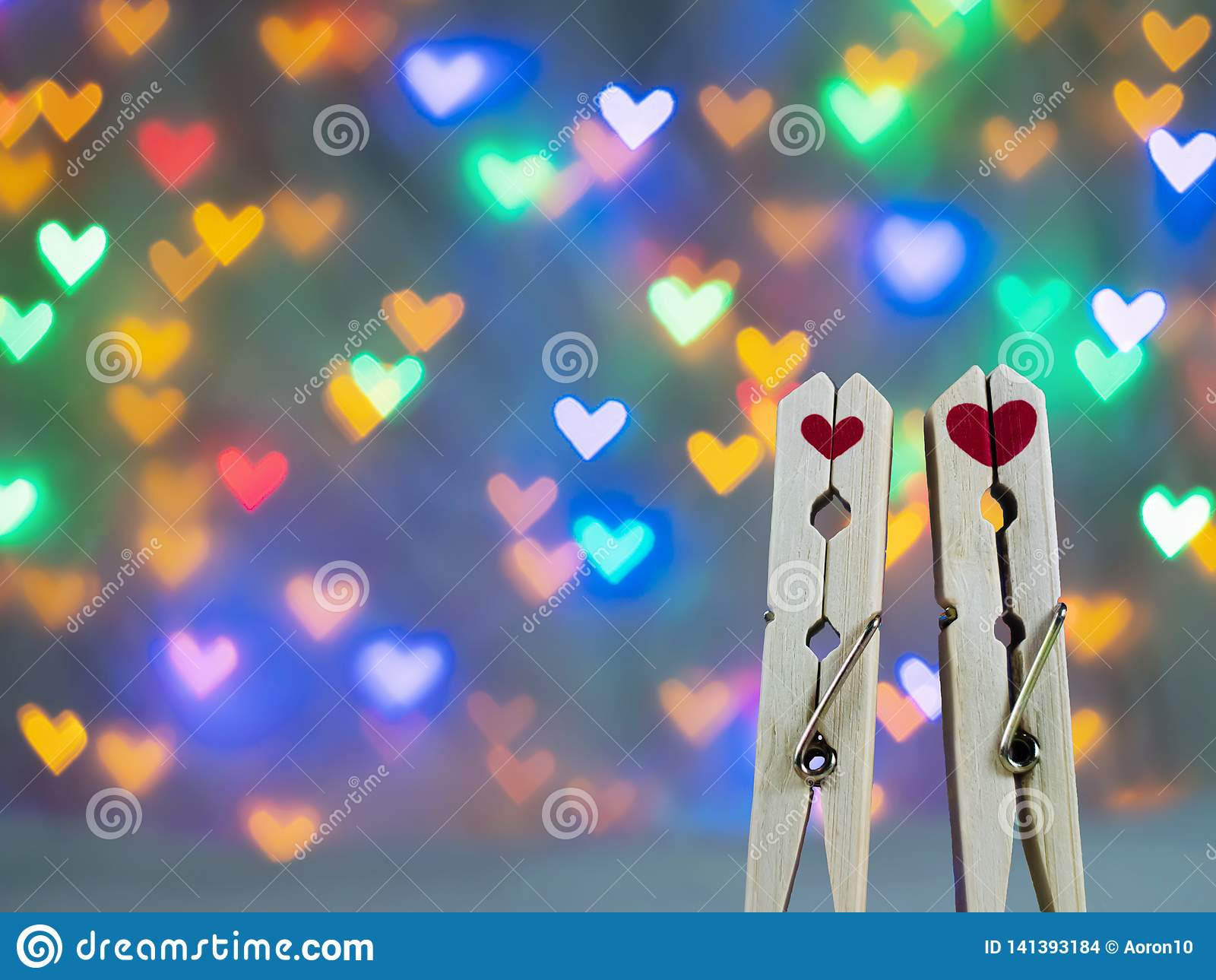 Cute wooden clothespin with red heart shape On a beautiful heart-shaped bokeh background For valentine