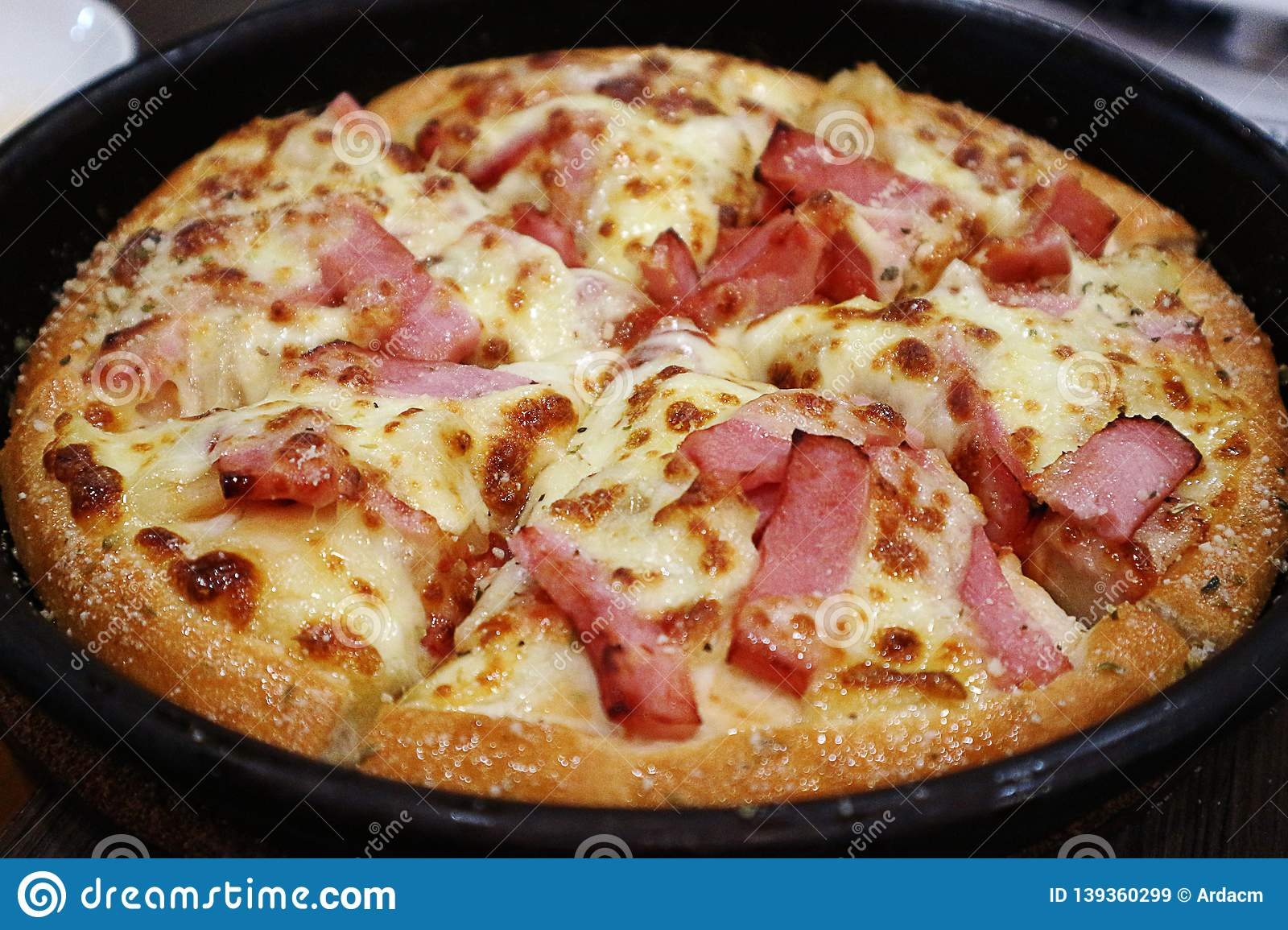Closeup of Delicious Bacon and Cheese Pizza