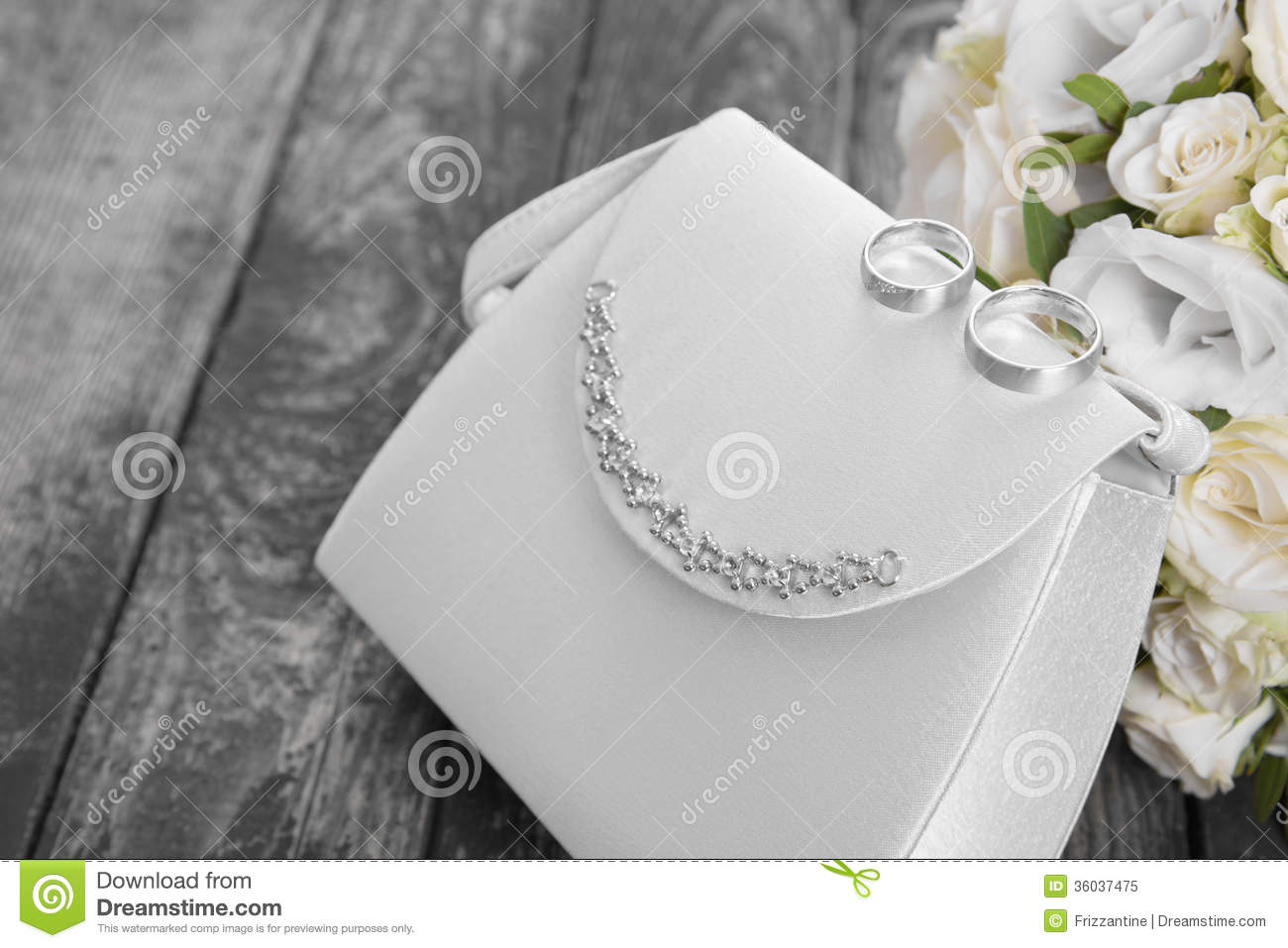 Closeup Detail Of Brides Bag Wedding Rings And Bridal Bouquet O