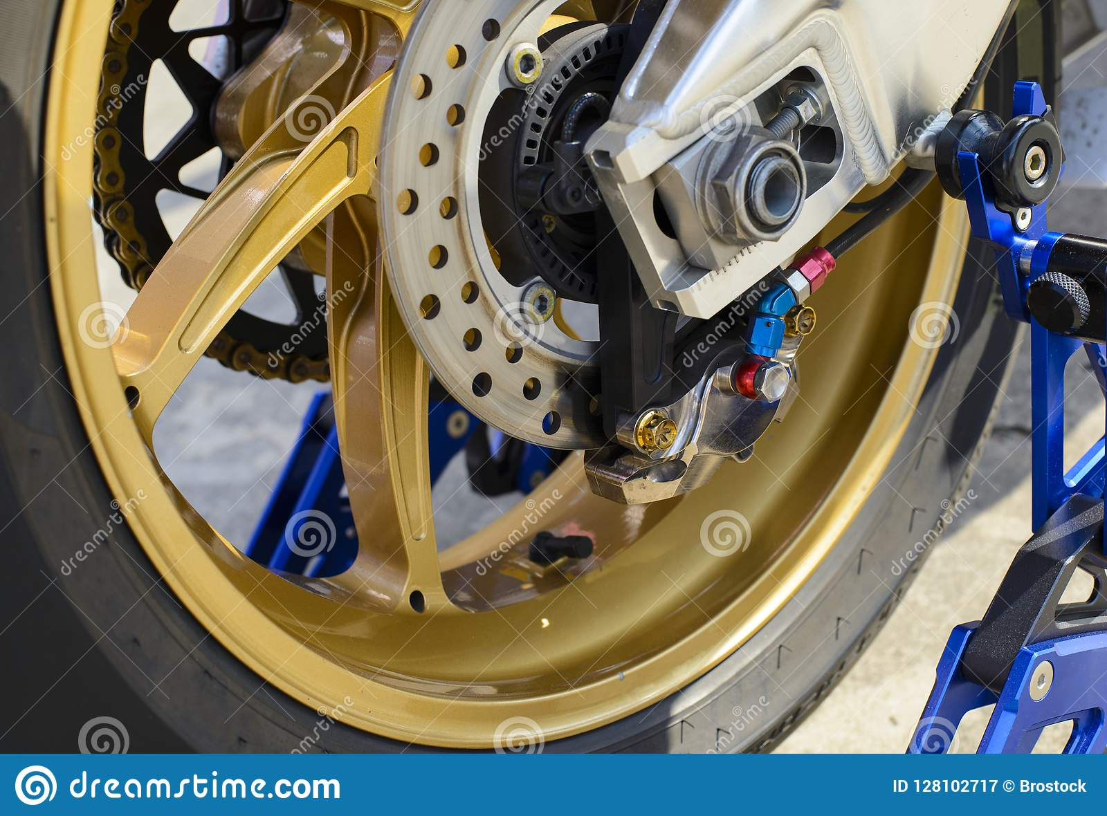 Closeup detail of a race motorcycle rear wheel and brake disc