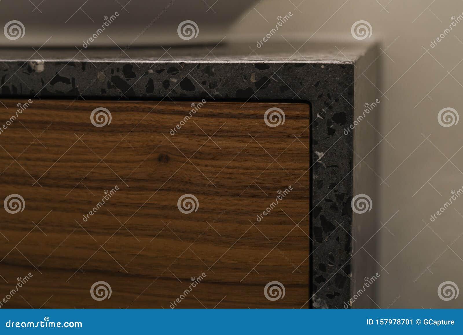 Closeup Detail Shot Of Gray Terrazzo Bathroom Cabinet With Black