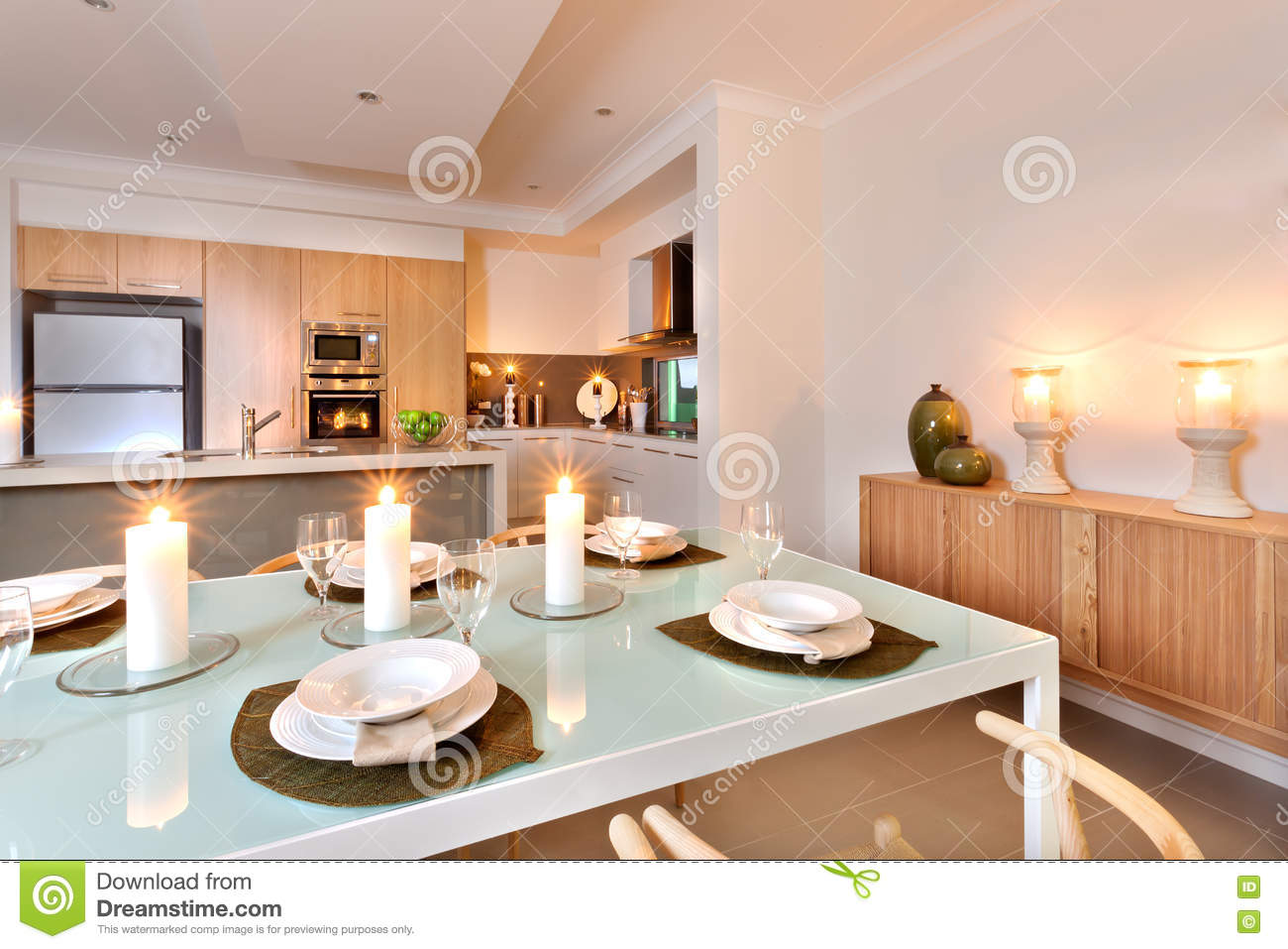 Closeup Of A Dining Table Set Up In Front Of The Kitchen With Fl