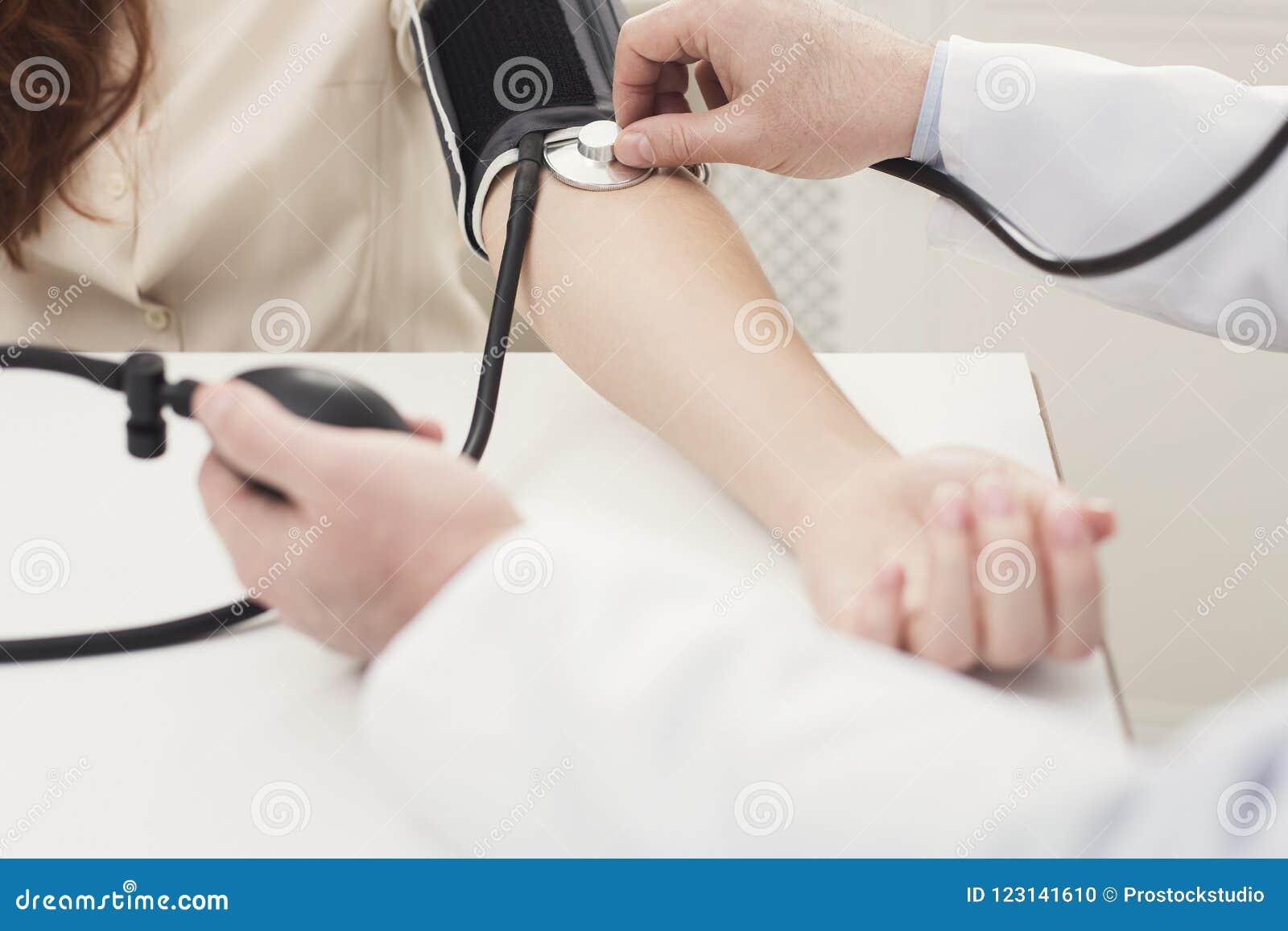 Closeup of doctor hand using tonometer