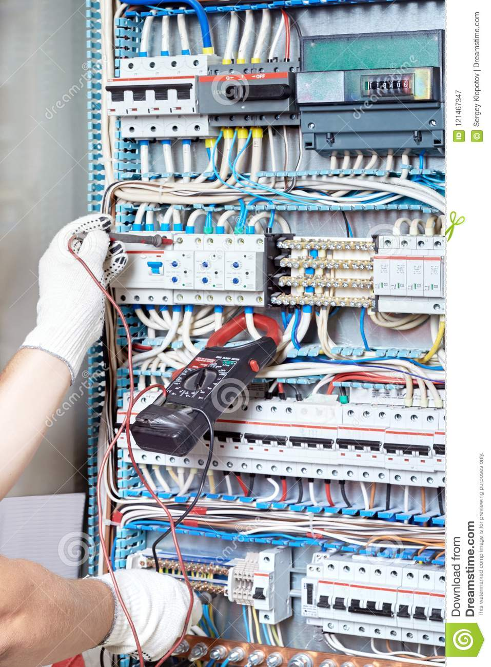 Closeup Of An Electrician`s Hand With A Diagnostic Tool In His H ...