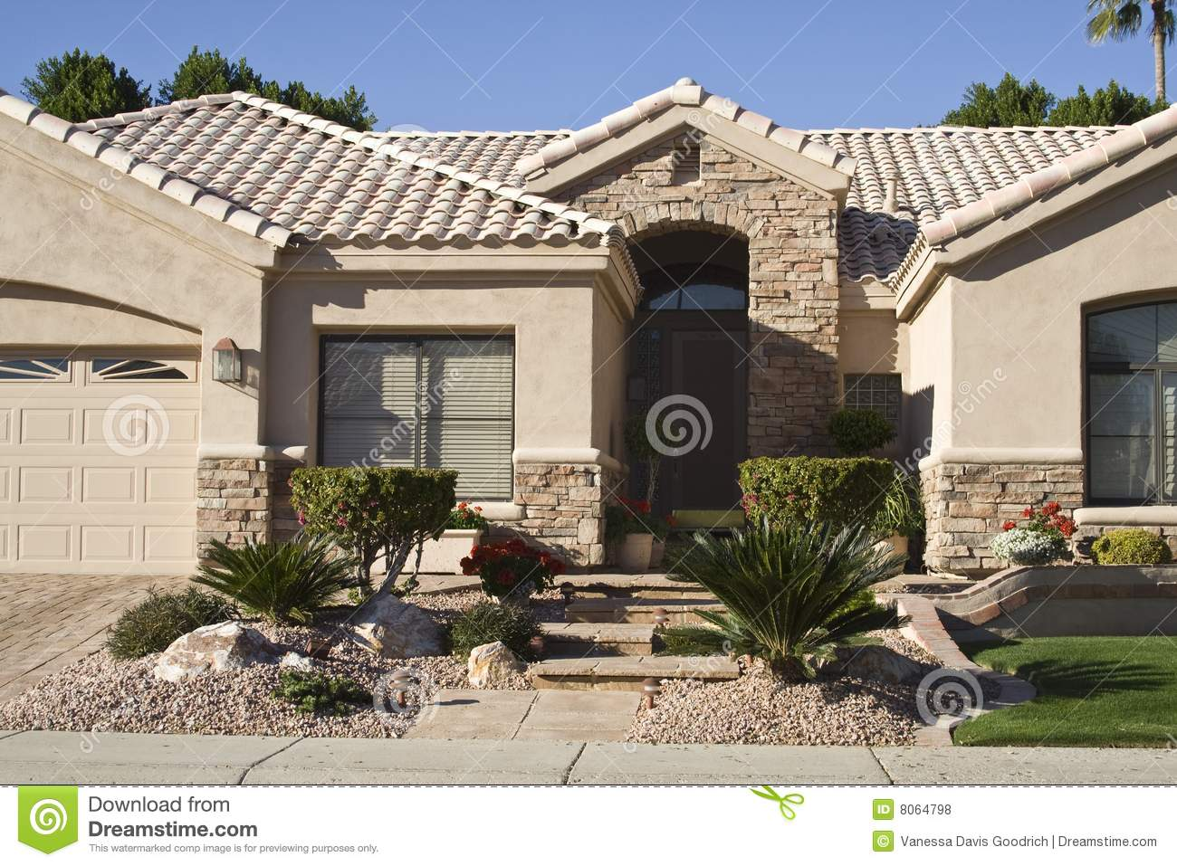 Closeup of entryway of modern adobe home stock photo for Modern adobe houses