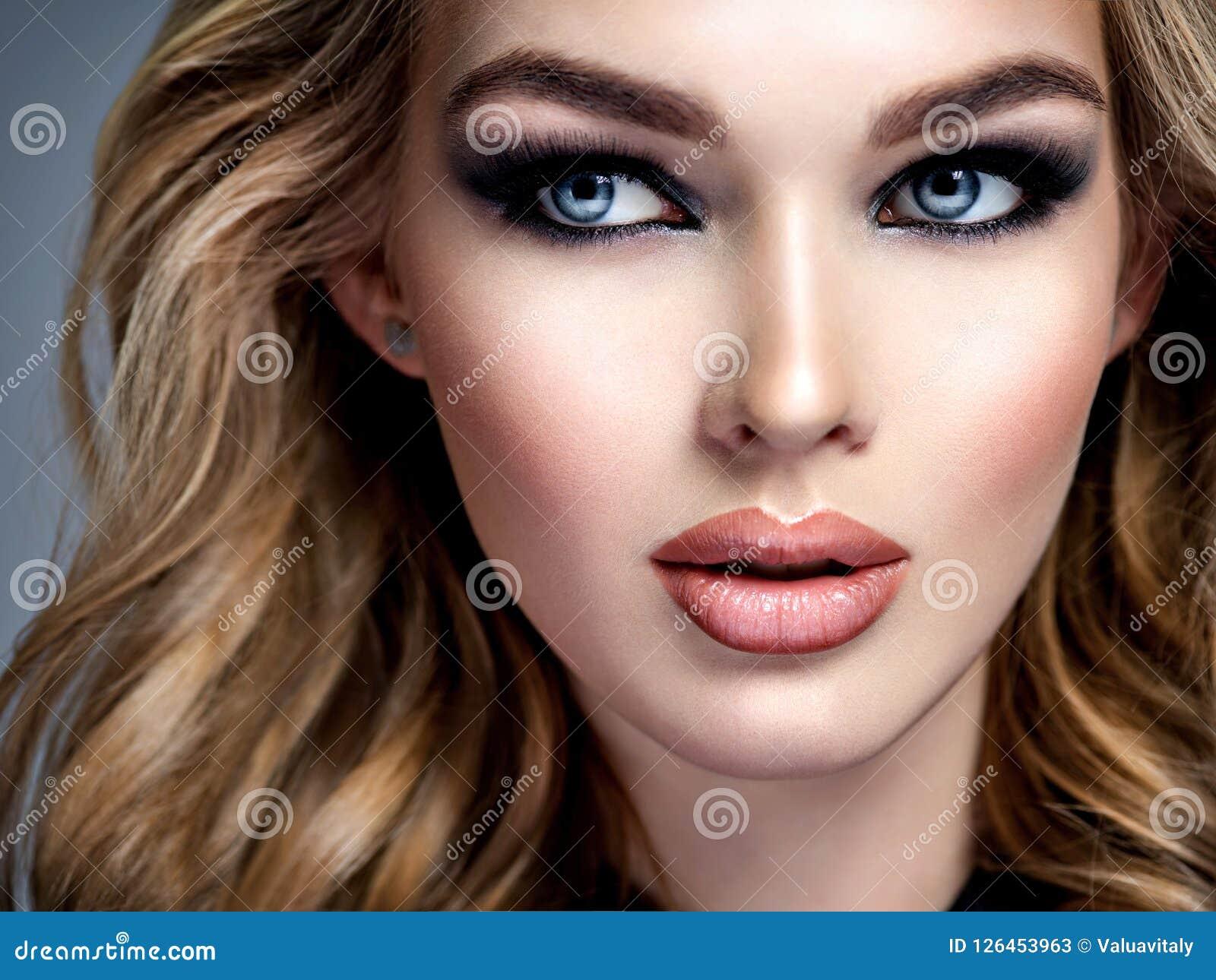 beautiful girl with makeup in style smoky eye