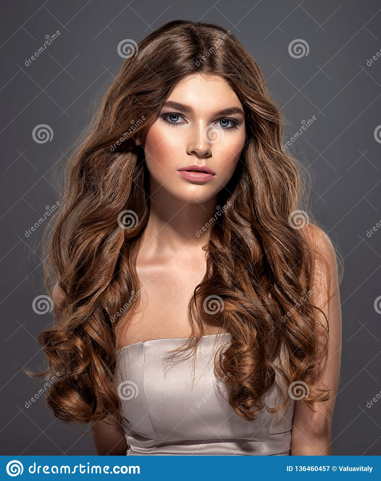 And Gorgeous Brown Haired Woman With Long Curly Hair Stock Image