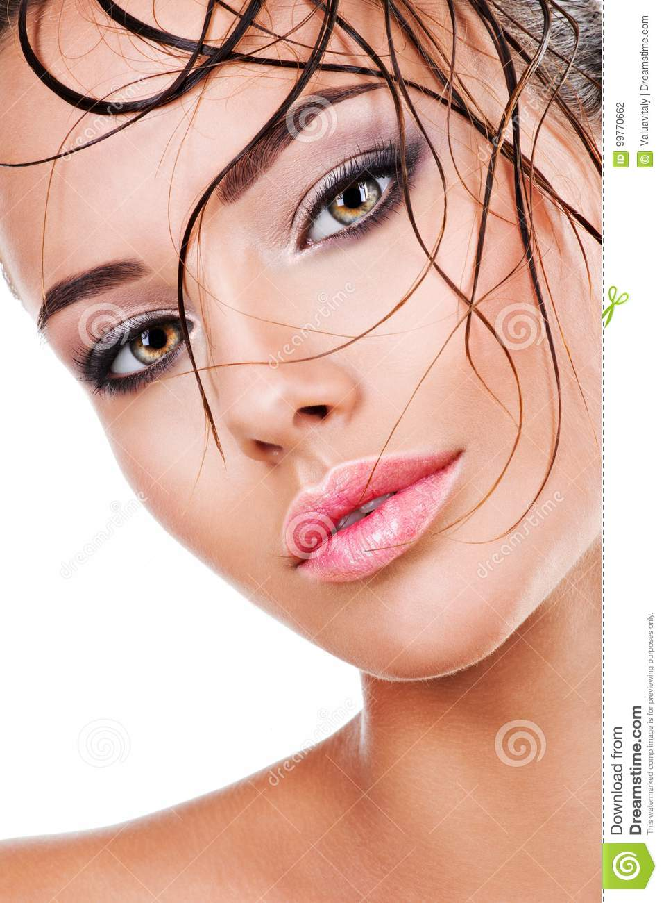Beautiful Face Of A Woman With Dark Brown Eye Makeup Stock Photo