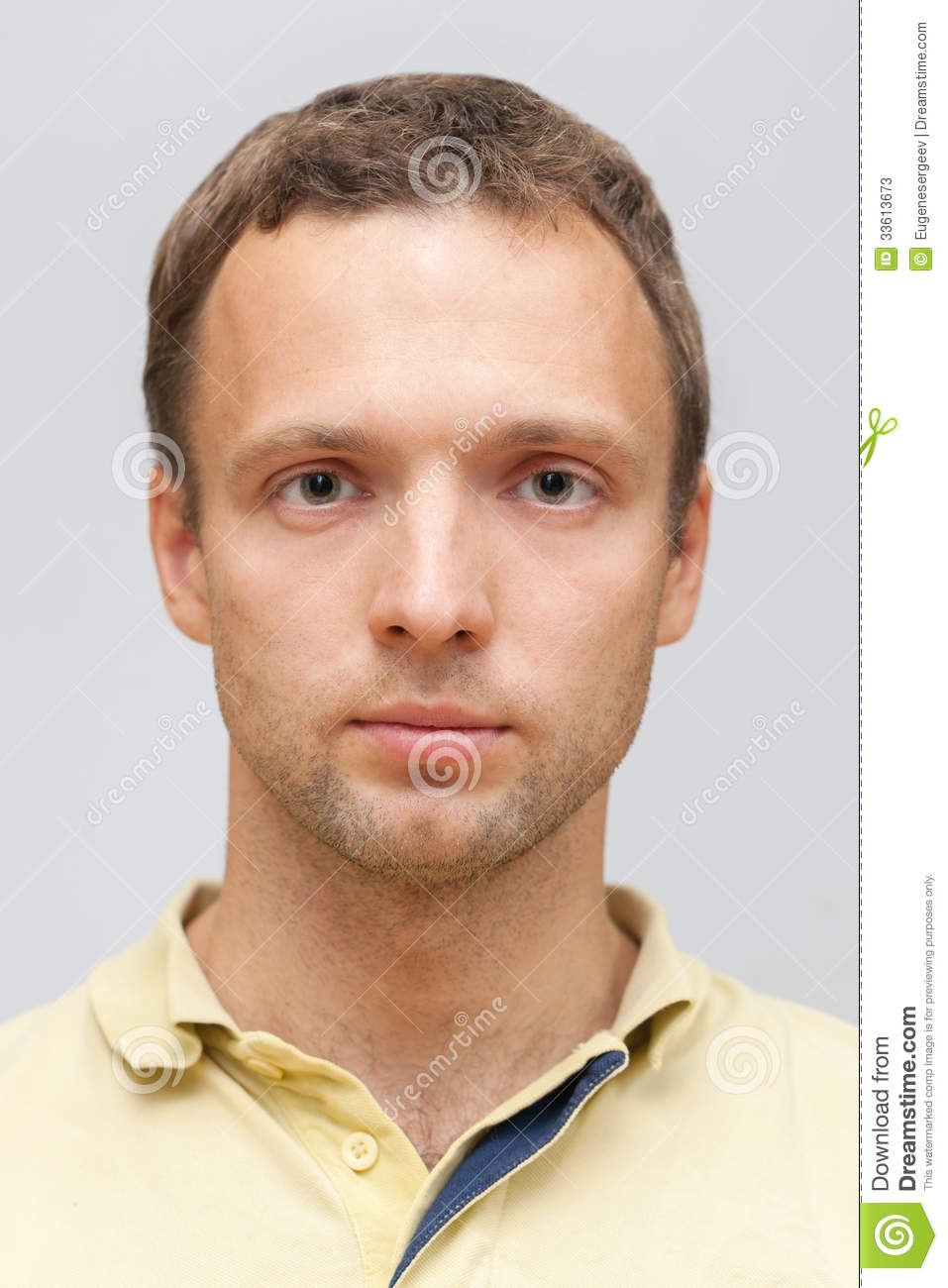 Closeup studio face portrait of young Caucasian ordinary man on gray ...