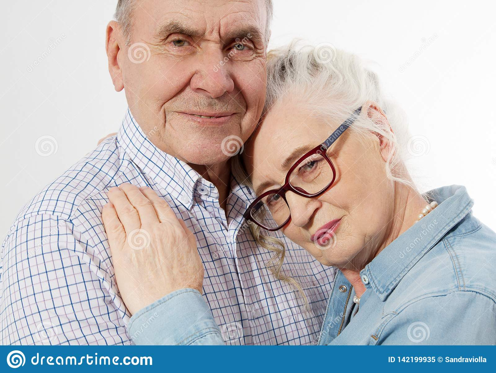 Closeup faces. Happy senior family couple isolated on white background. Close up portrait woman and man with wrinkled face.
