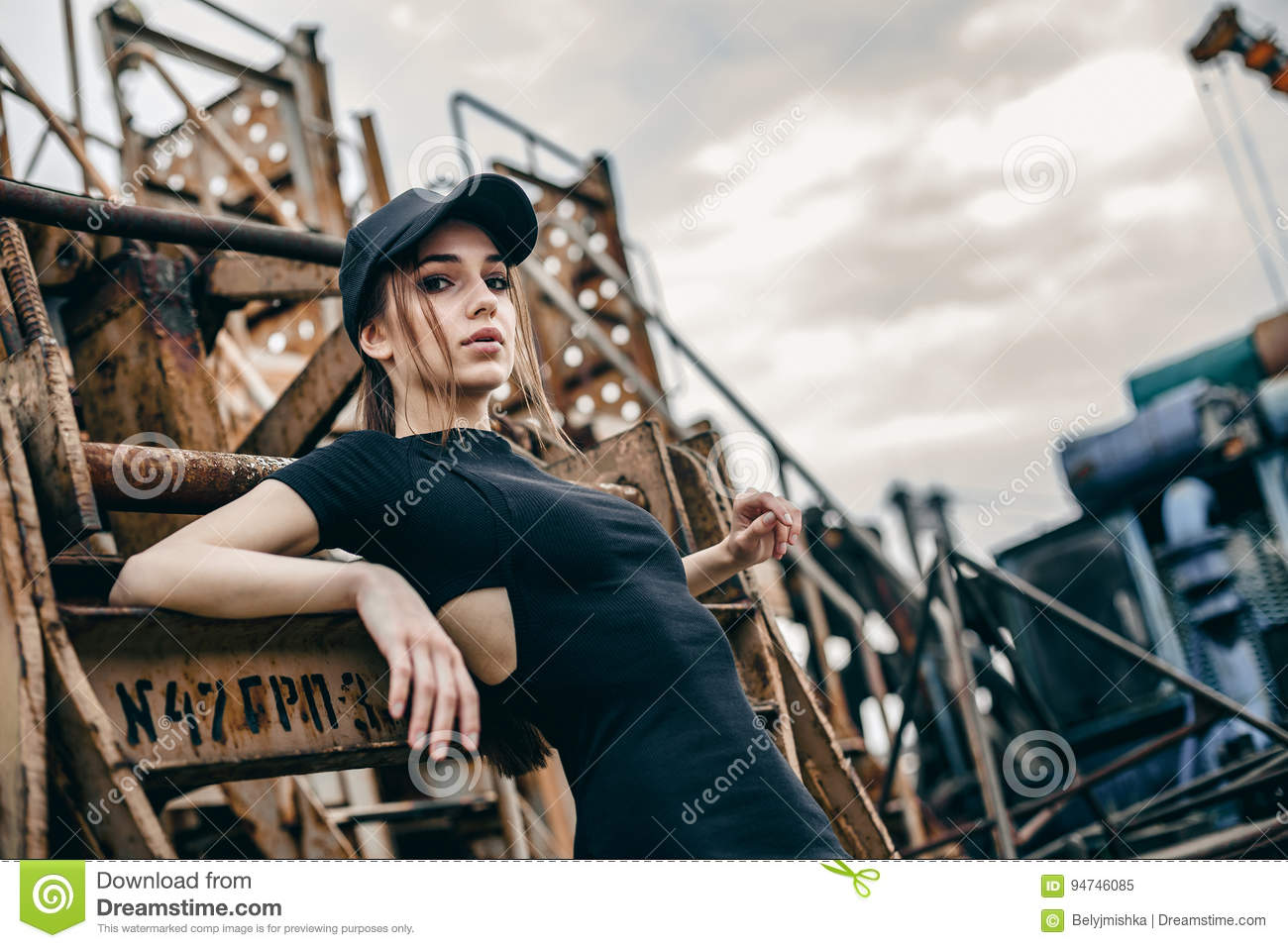 Closeup fashion portrait of hipster young tender woman in black cap
