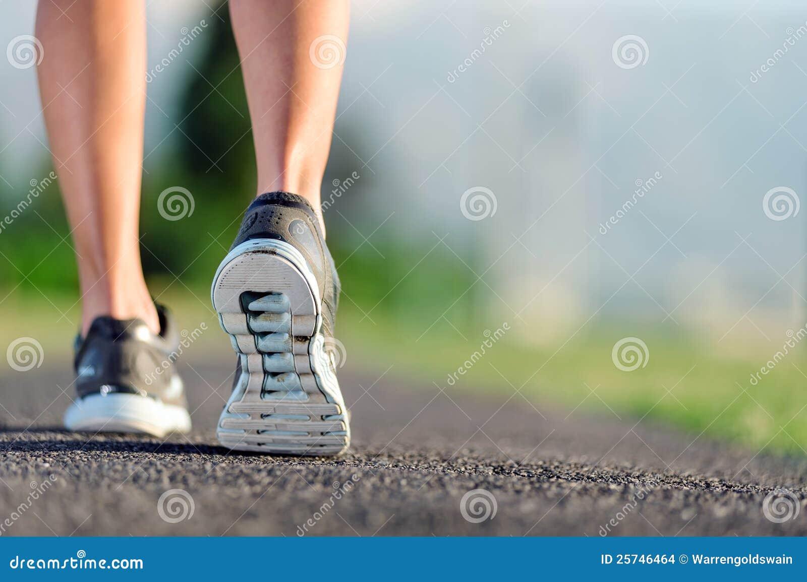 Closeup of feet on pathway