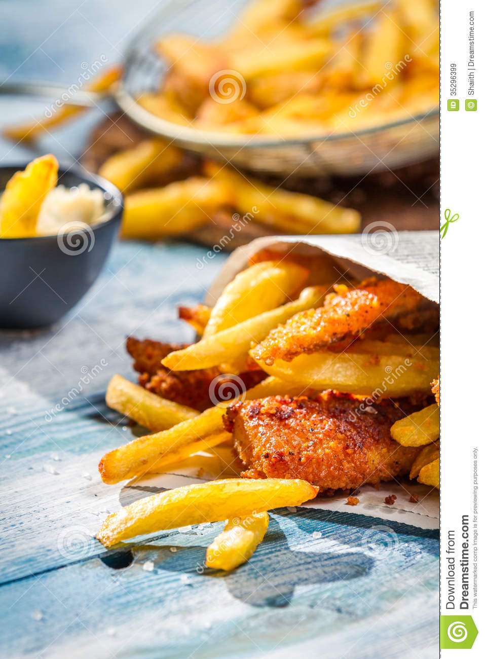 Closeup of fish chips served in the newspaper stock for Fish and chips newspaper