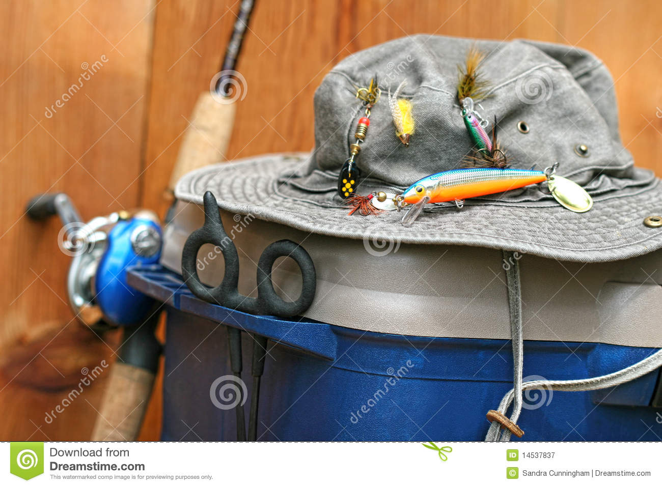 Closeup of fishing tackle box and hat stock image image for How to get free fishing gear