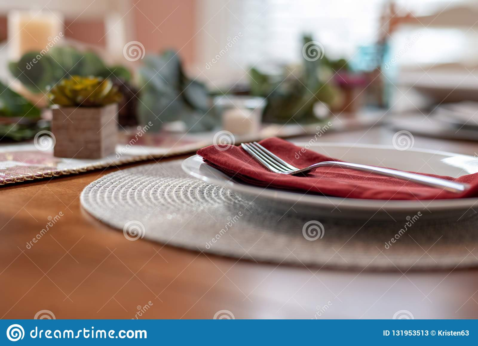 Closeup of fork and plate on table at home