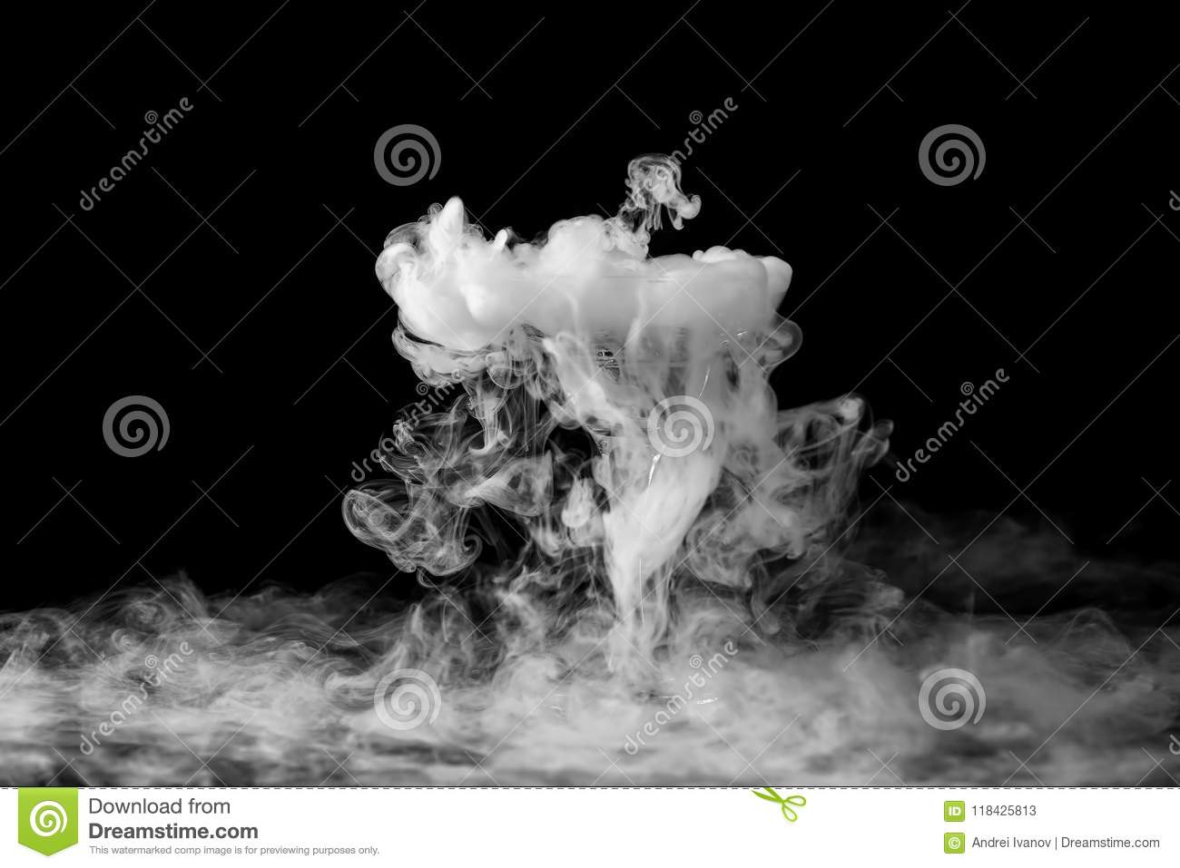 Closeup glass with white fog at dark background chemical reaction