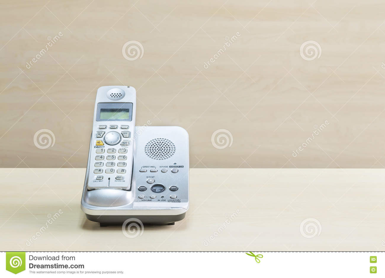 Closeup gray phone office phone on blurred wooden desk and wall royalty free stock photo m4hsunfo Gallery