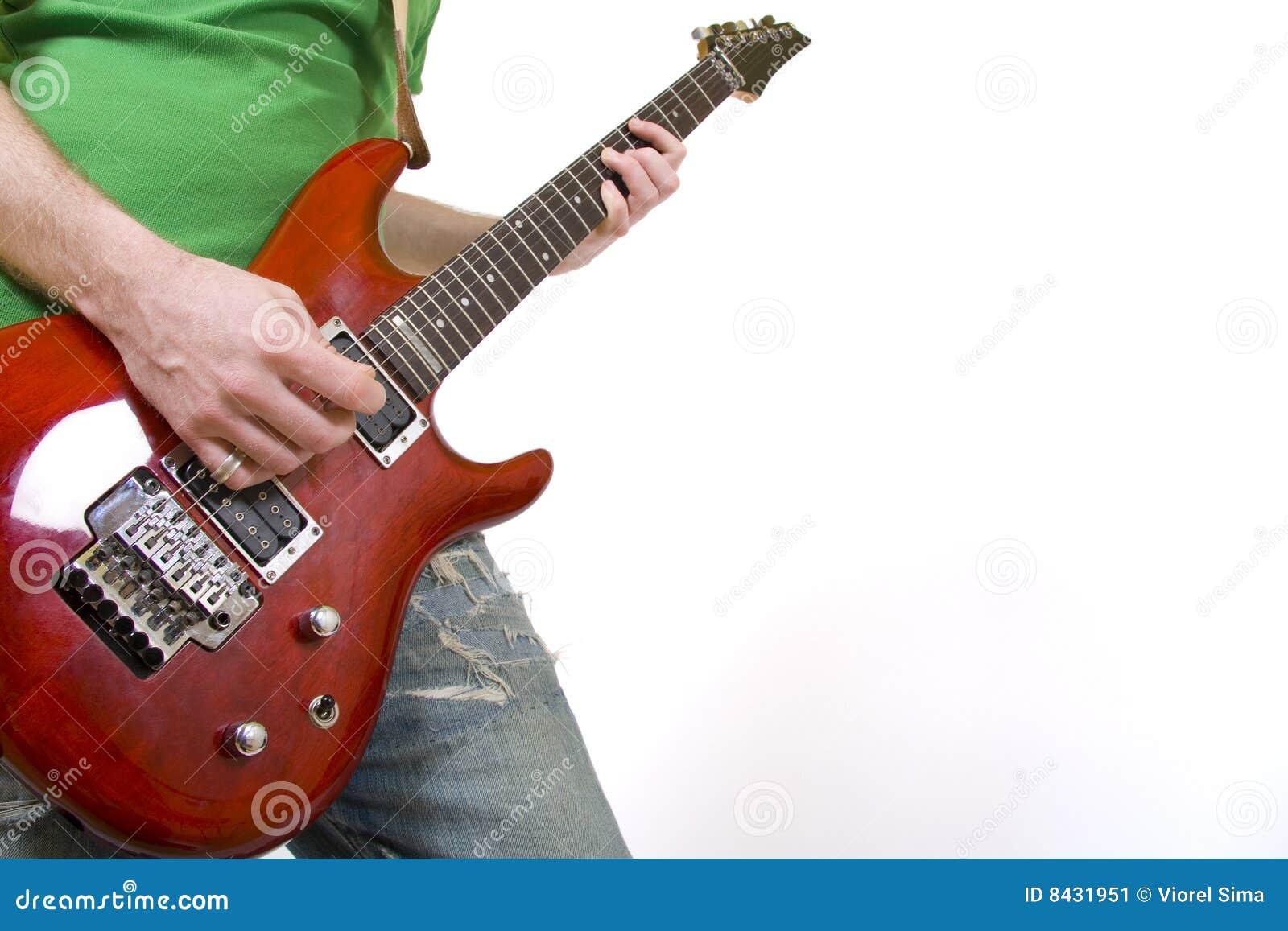 Closeup of a guitarist playing sn electric guitar