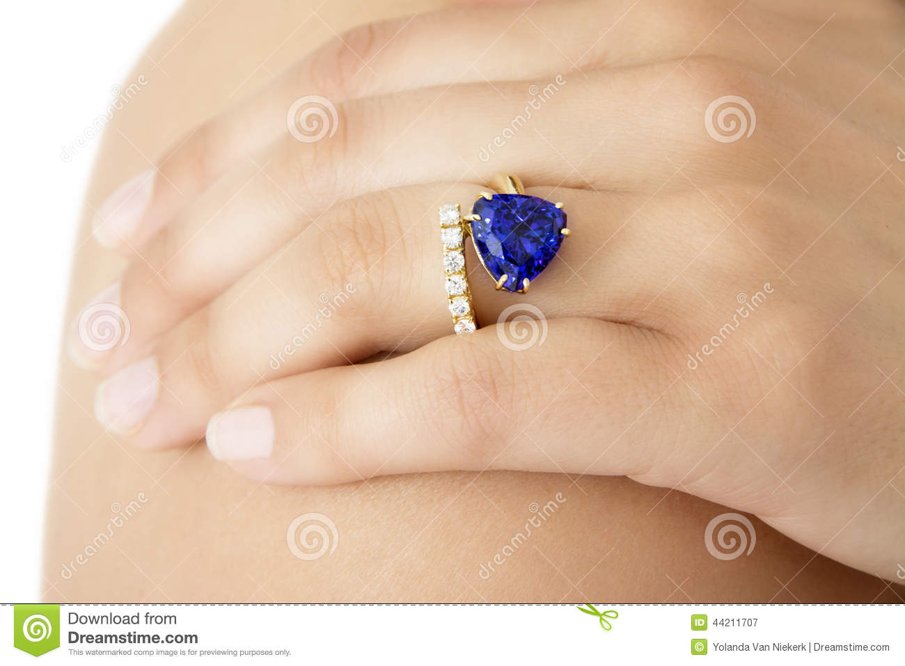 Closeup Of A Hand With A Designer Ring Of Tanzanite Stock