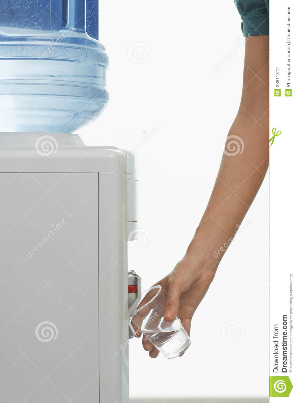 Closeup Of Hand Pouring Water From Cooler Stock Photo
