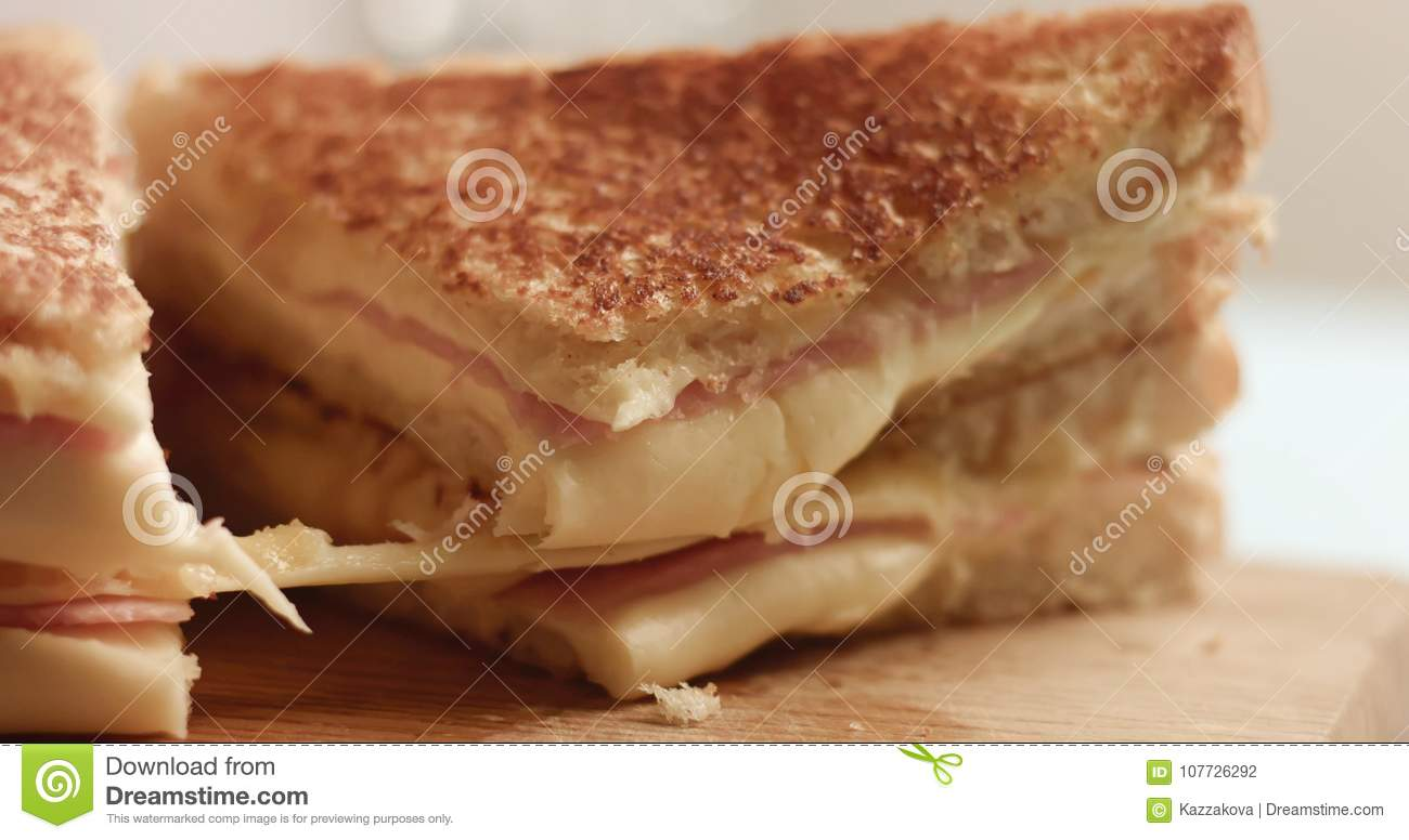 Closeup of handmade delicious sandwich with ham and cheese